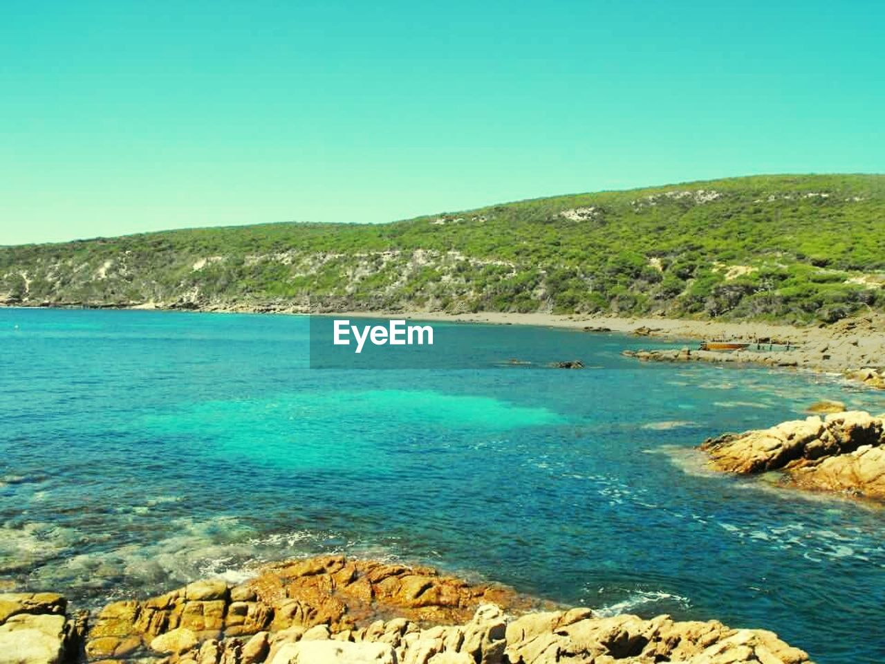 sea, blue, clear sky, nature, tranquil scene, scenics, rock - object, beauty in nature, tranquility, day, outdoors, water, no people, beach, horizon over water, sky