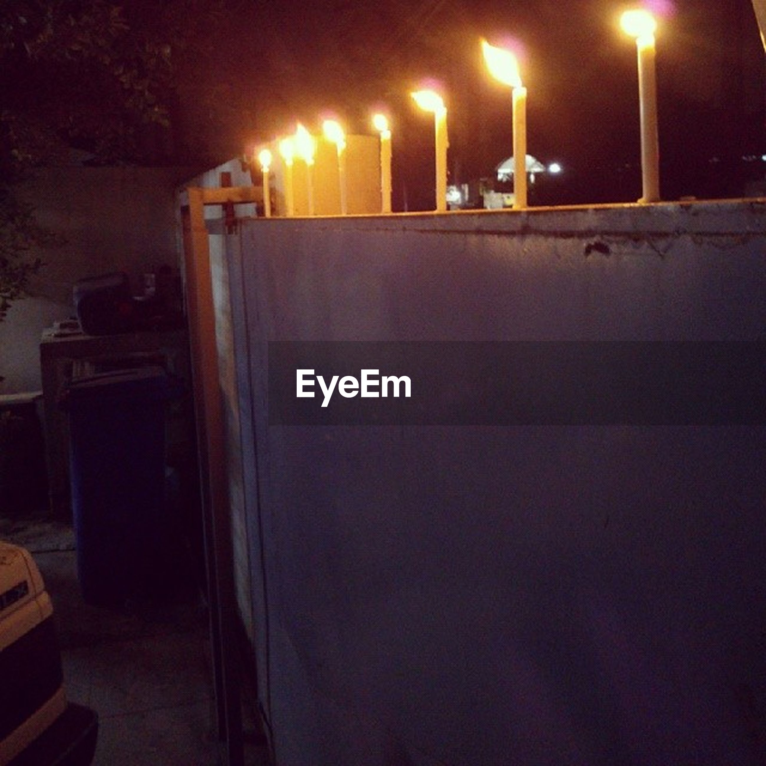illuminated, night, indoors, lighting equipment, glowing, lit, electricity, light - natural phenomenon, candle, burning, dark, electric light, wall - building feature, flame, heat - temperature, no people, fire - natural phenomenon, darkroom, wood - material, close-up