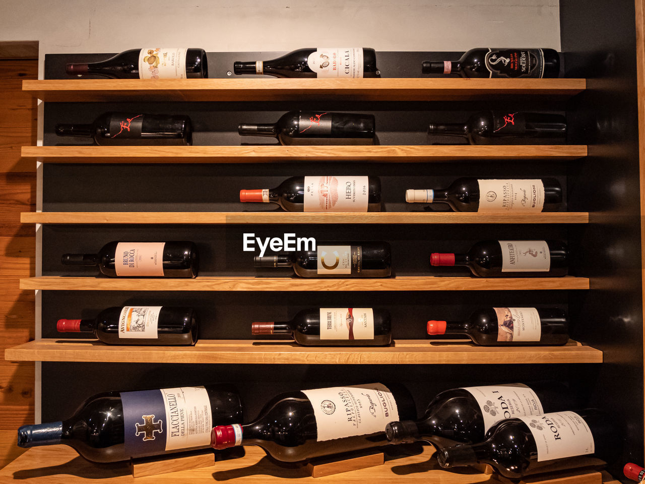 shelf, large group of objects, order, in a row, indoors, choice, abundance, container, arrangement, bottle, variation, alcohol, wine bottle, refreshment, no people, collection, wood - material, shelves, drink, wine