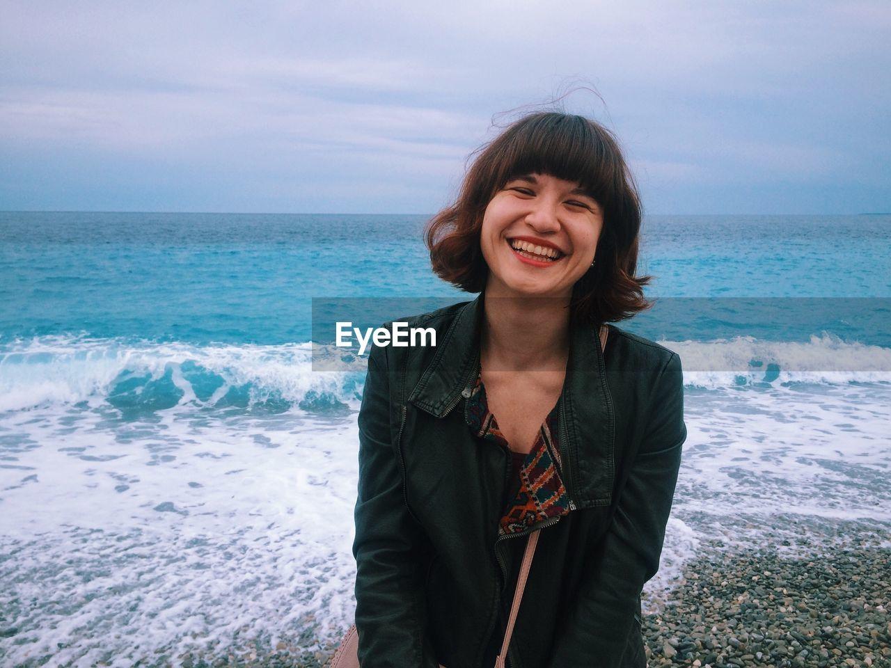 Cheerful Woman Standing At Seashores