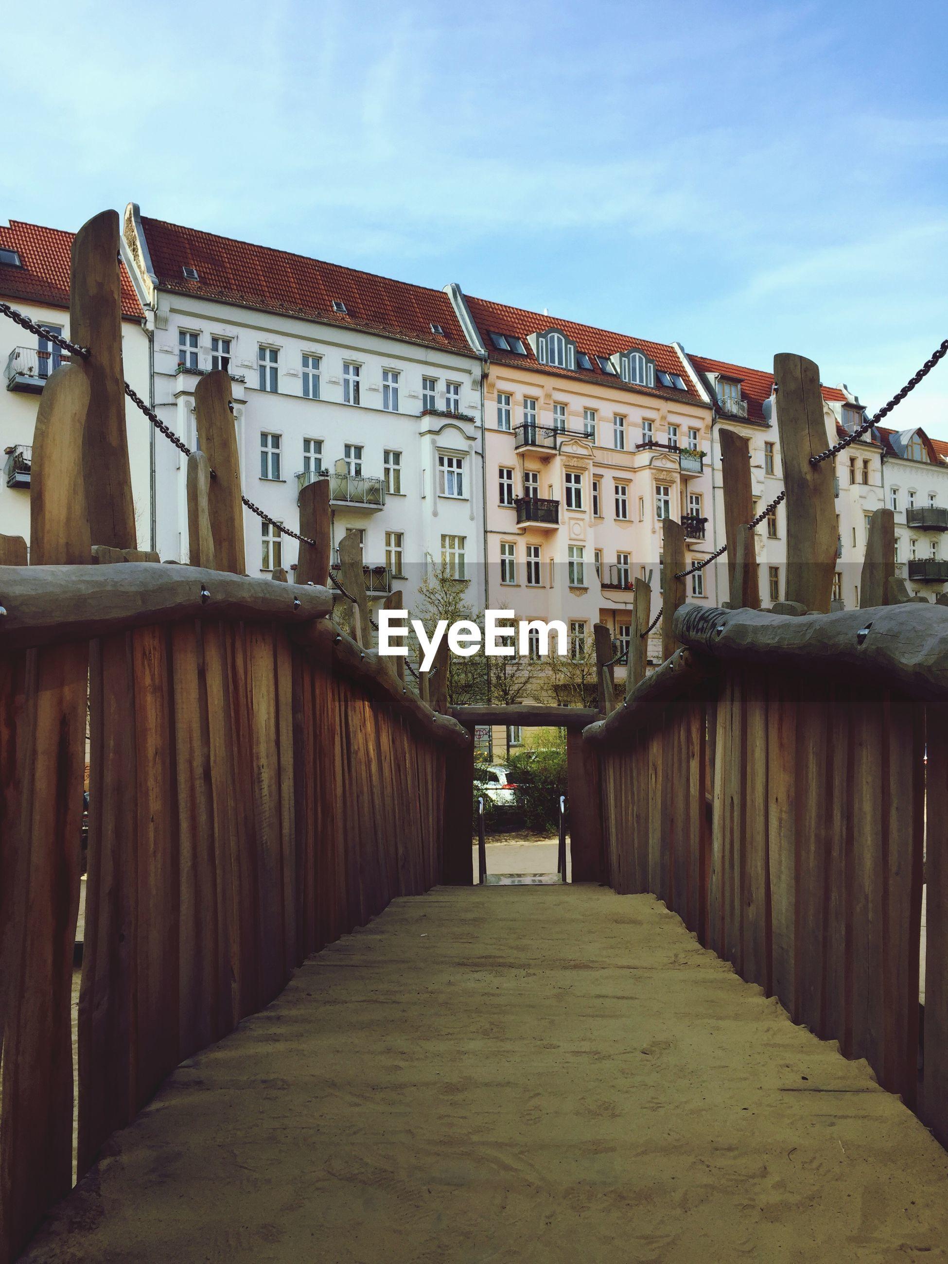 View of footbridge leading towards buildings