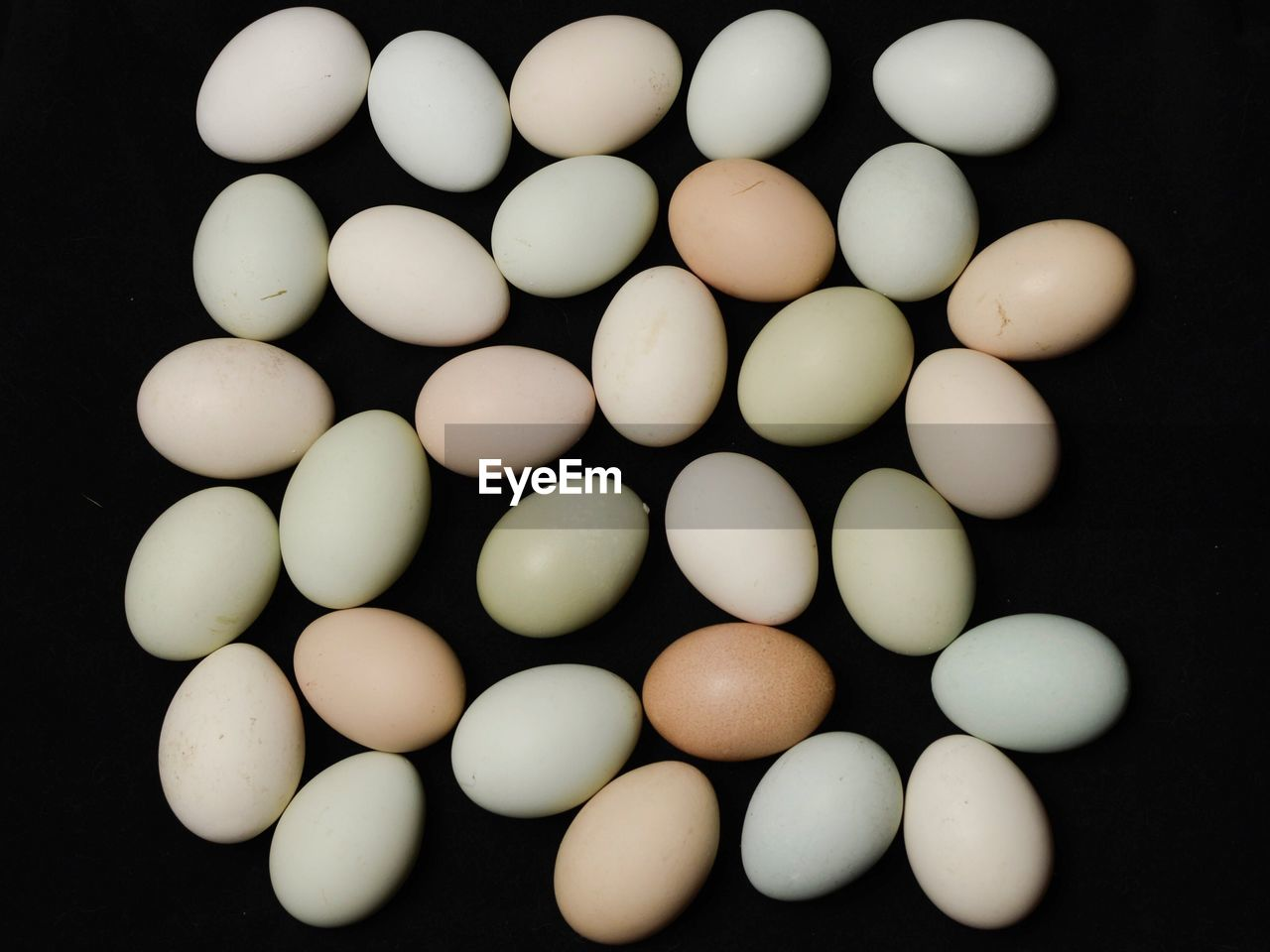 egg, studio shot, black background, food, white color, large group of objects, no people, food and drink, high angle view, indoors, close-up, egg carton, fragility, freshness, day