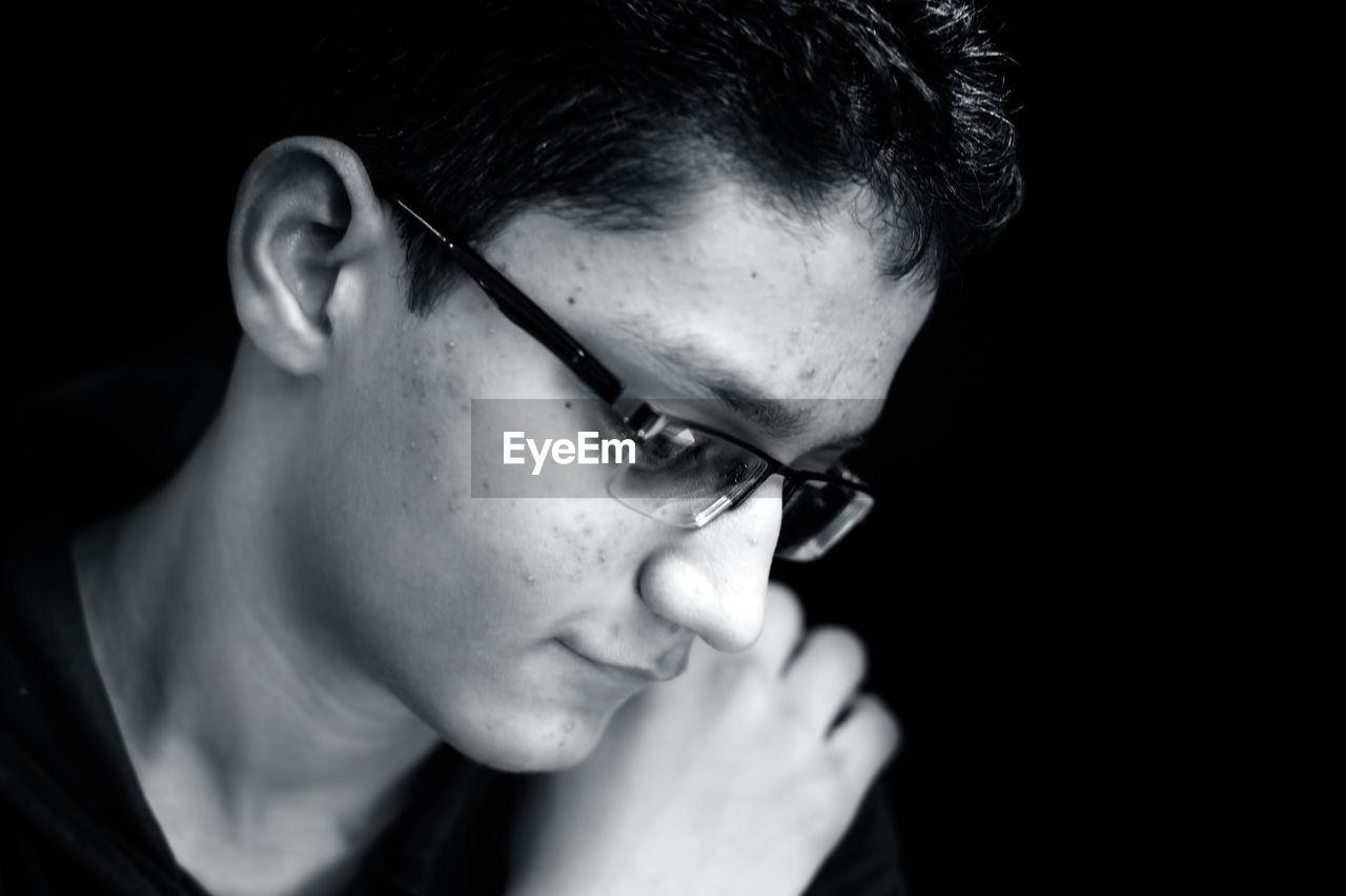 Close-up thoughtful teenage boy looking away