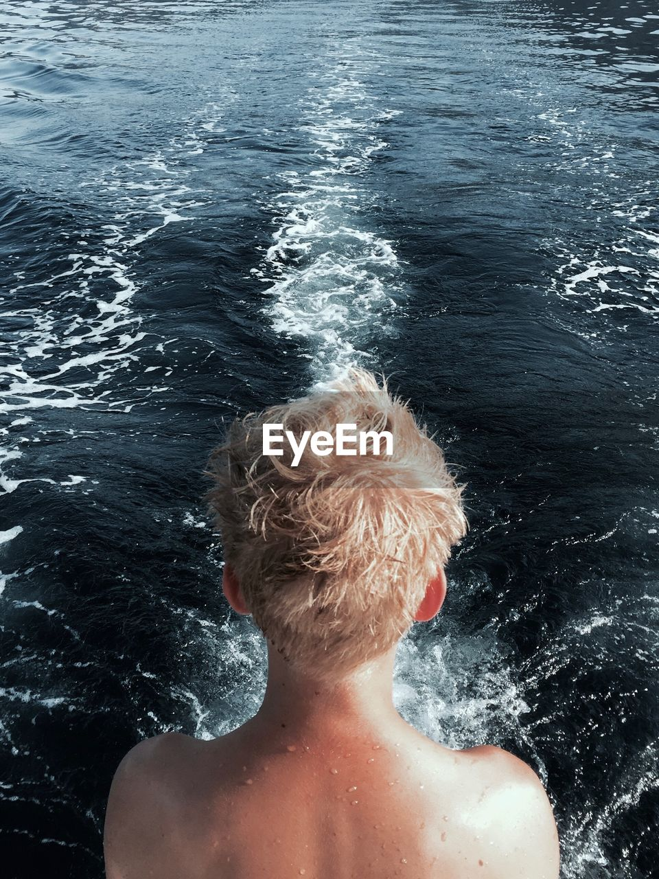 Rear View Of Shirtless Boy Against Sea