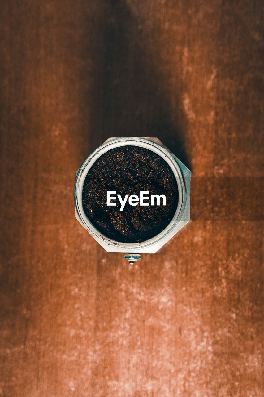 indoors, no people, directly above, table, metal, close-up, still life, drink, food and drink, wood - material, focus on foreground, refreshment, brown, single object, day, geometric shape, circle, shape, cup, freshness, wood grain
