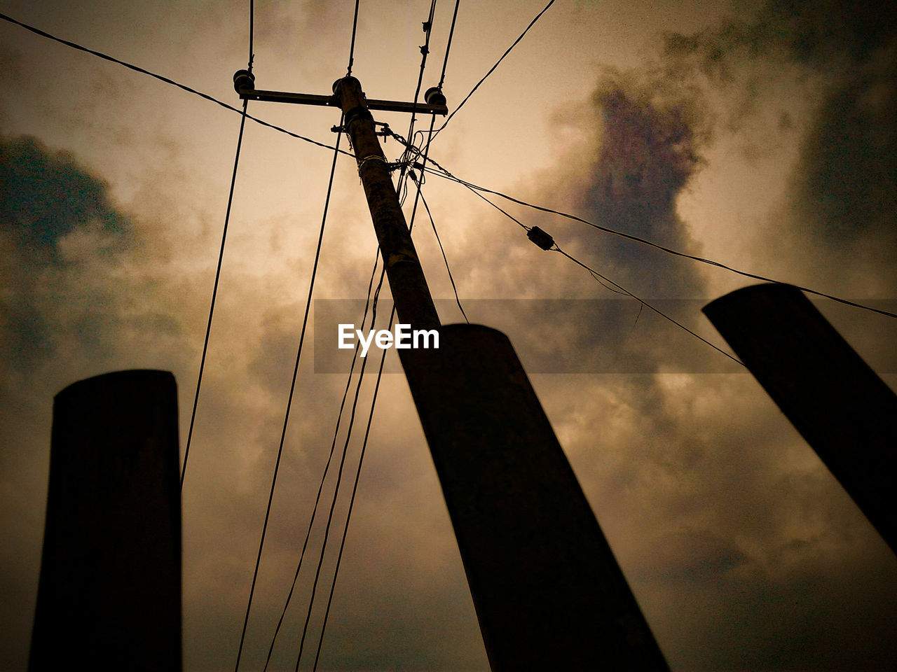 cable, connection, low angle view, sky, power line, no people, silhouette, power supply, cloud - sky, technology, outdoors, electricity, fuel and power generation, electricity pylon, day, nature
