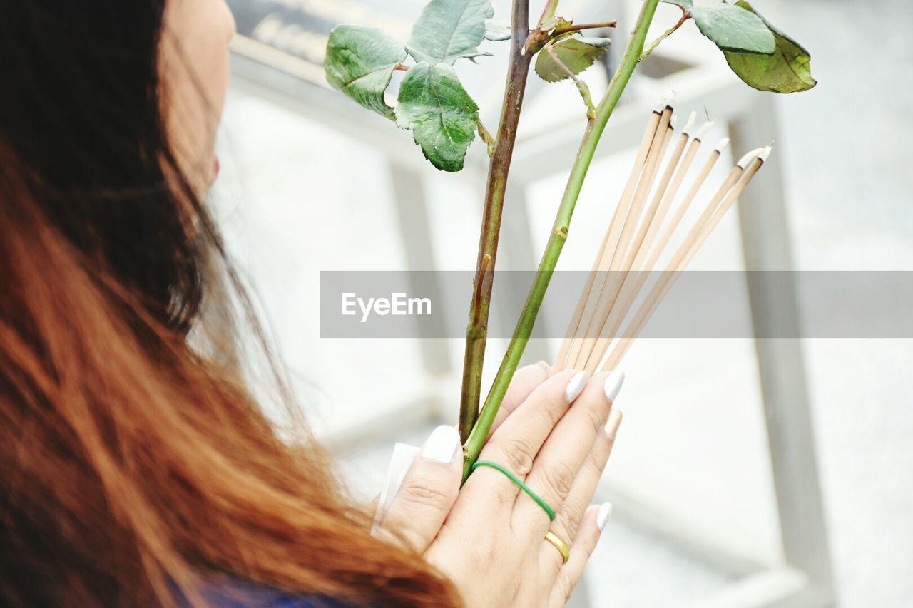 Woman Holding Incense Sticks