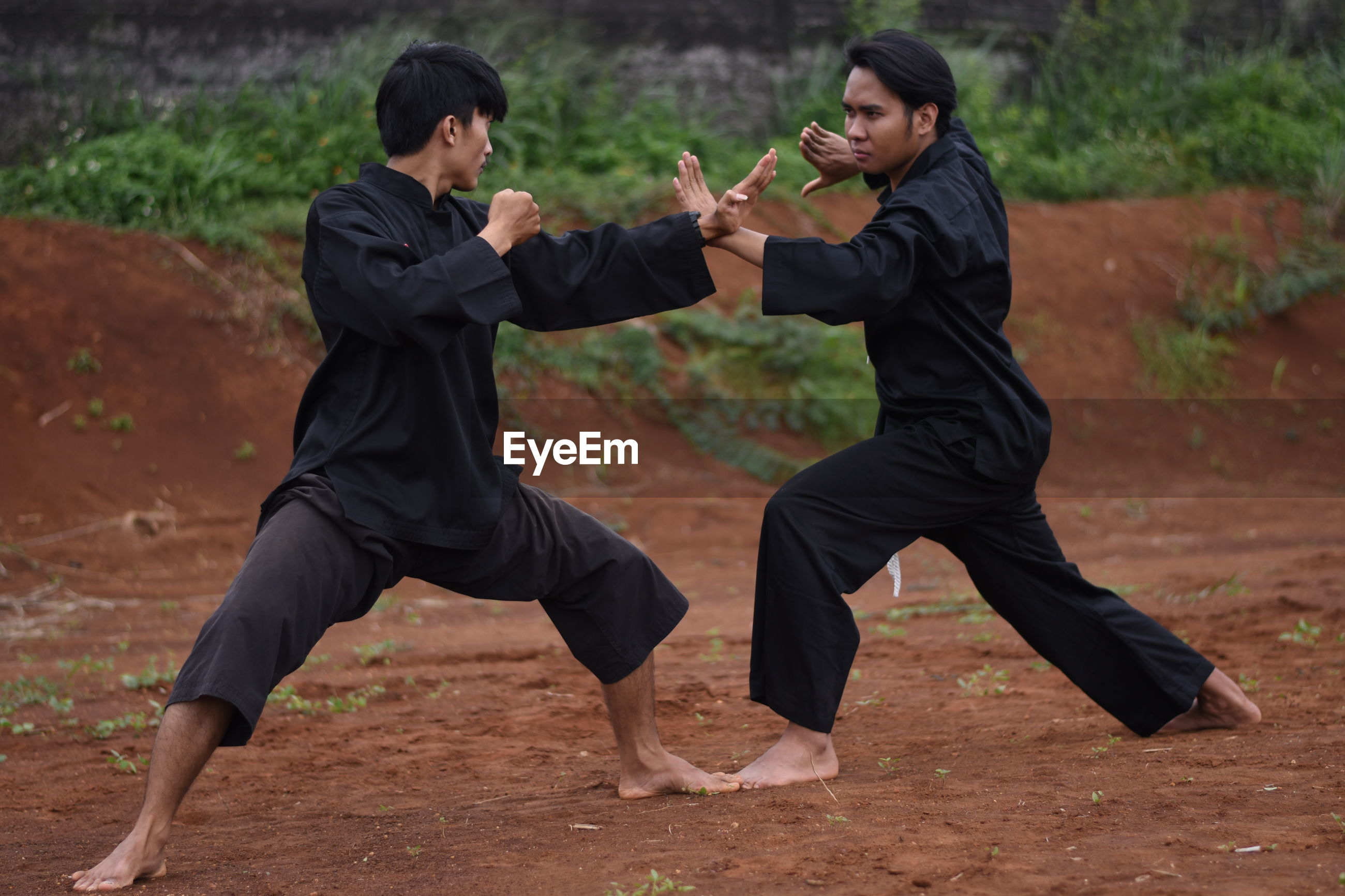 Young men practicing karate outdoors
