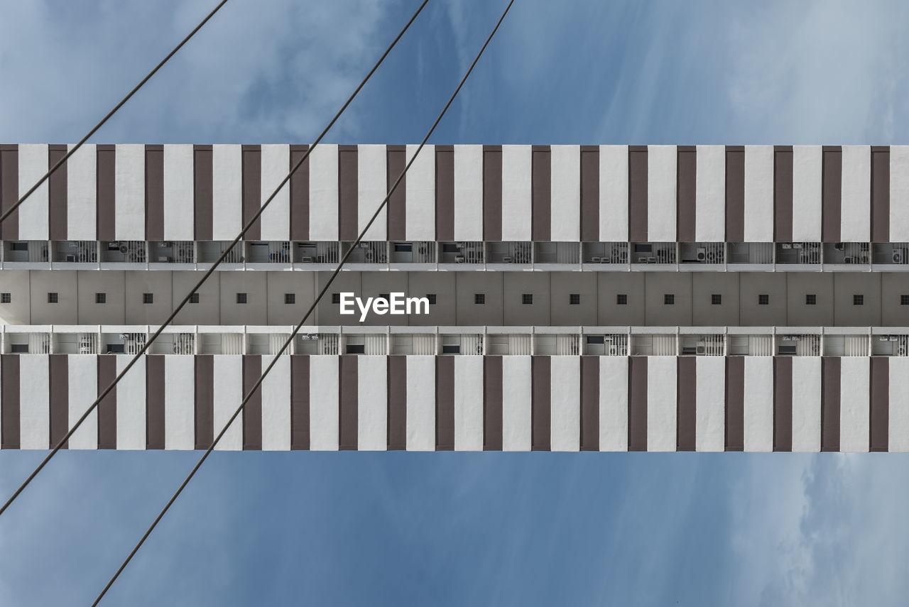 Directly Below Shot Of Bridge Against Sky