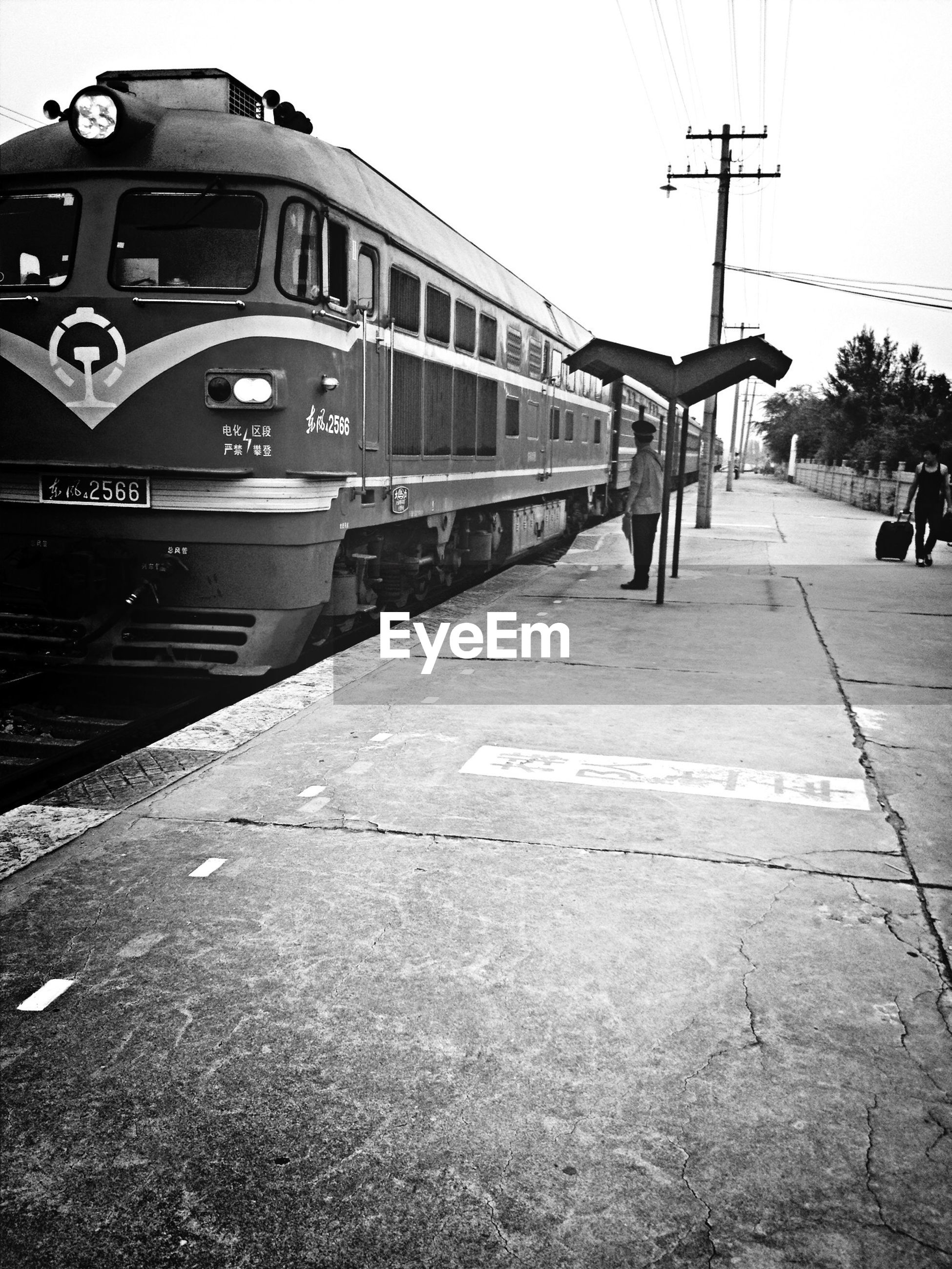 transportation, railroad track, clear sky, rail transportation, built structure, mode of transport, architecture, public transportation, connection, building exterior, sky, the way forward, diminishing perspective, day, train - vehicle, outdoors, power line, cable, no people, railroad station
