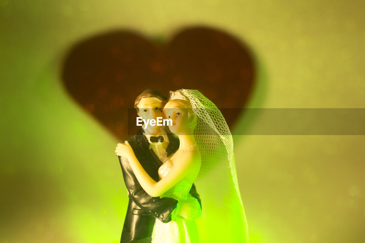 two people, love, togetherness, women, green color, couple - relationship, emotion, adult, bonding, heterosexual couple, studio shot, young adult, positive emotion, females, fashion, young women, yellow, indoors, people, waist up, beautiful woman, hairstyle