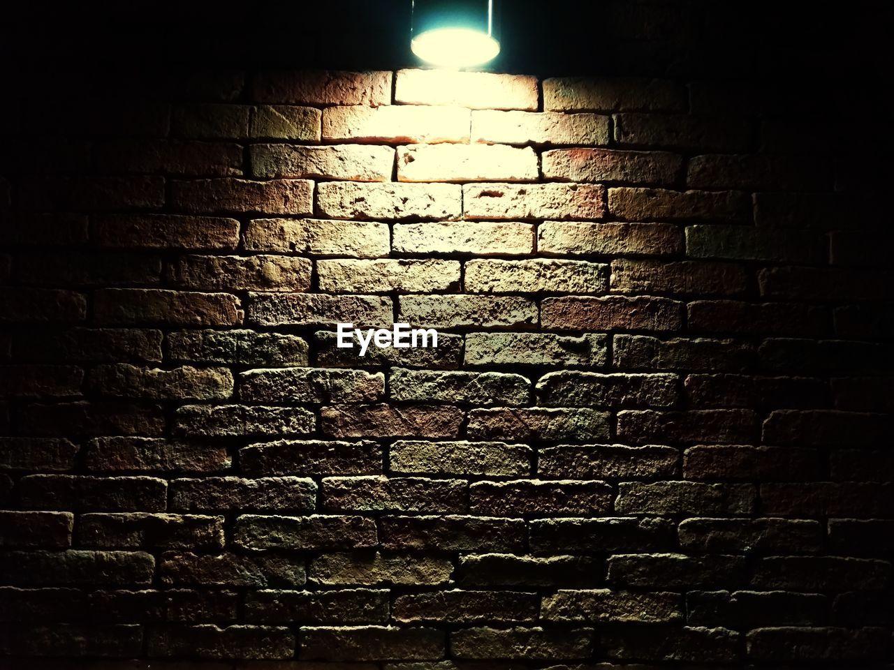 brick wall, no people, night, indoors, illuminated, close-up