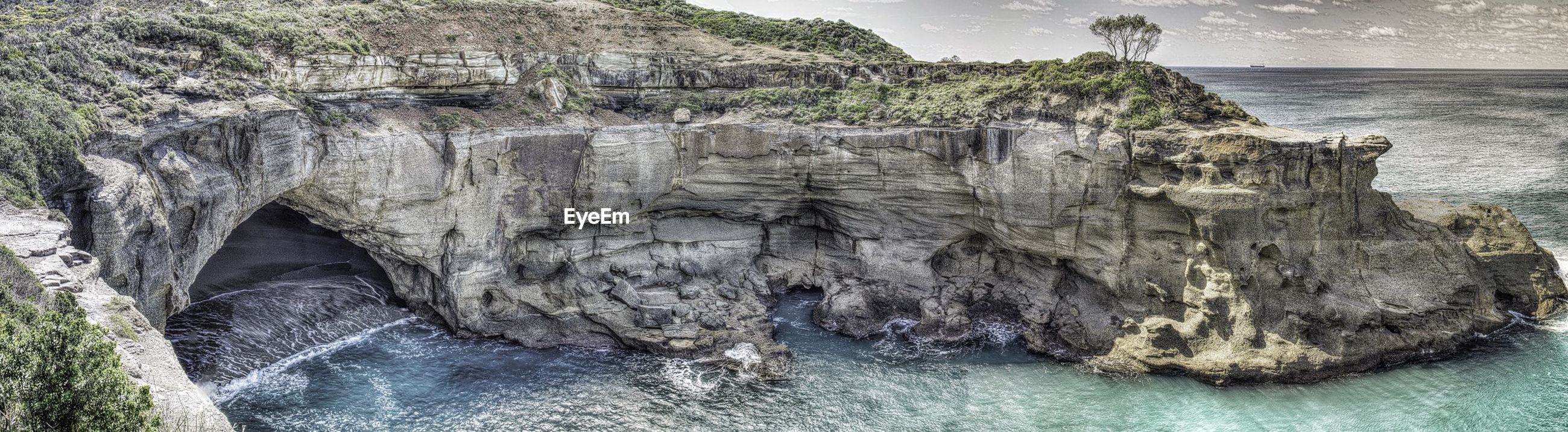 water, rock formation, sea, tranquil scene, scenics, tranquility, rock - object, beauty in nature, nature, cliff, rock, geology, idyllic, eroded, beach, horizon over water, non-urban scene, high angle view, shore, outdoors