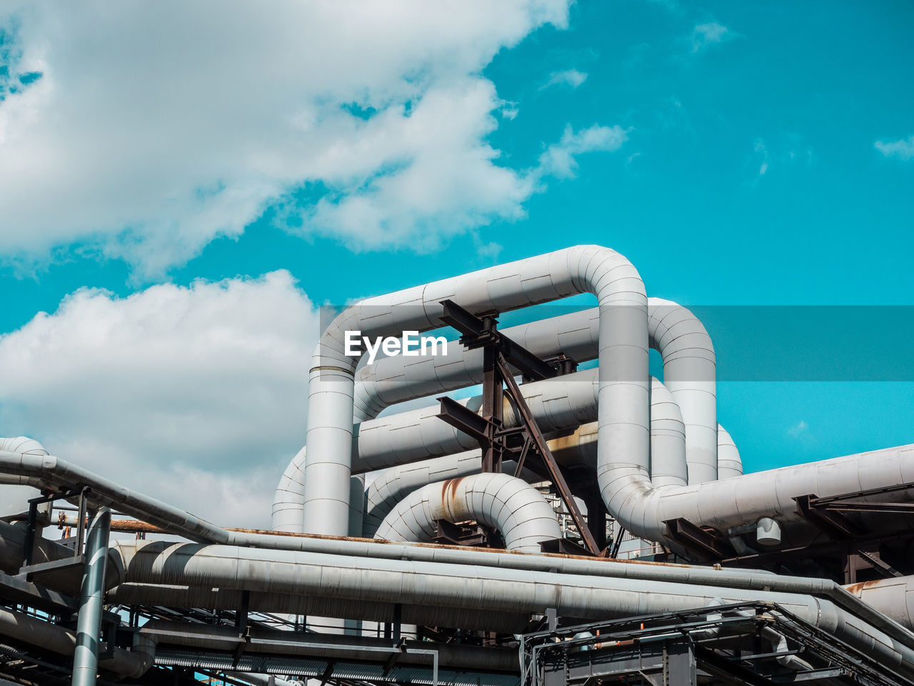 Low Angle View Of Gas Pipes At Industry Against Sky