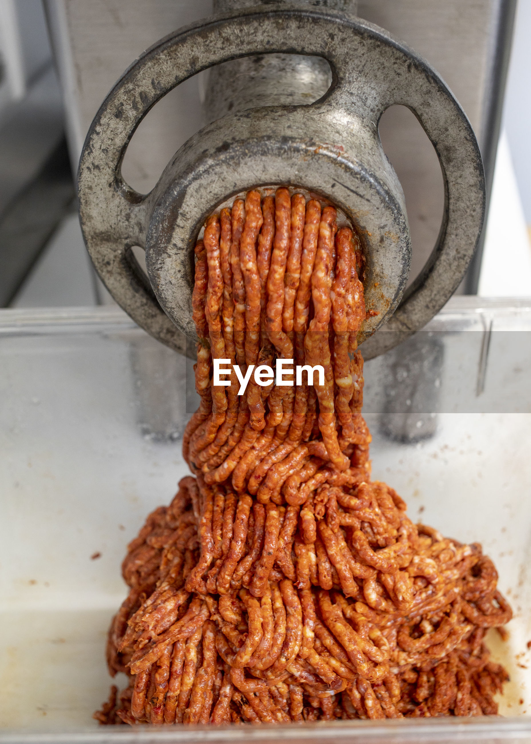 HIGH ANGLE VIEW OF MEAT ON METAL