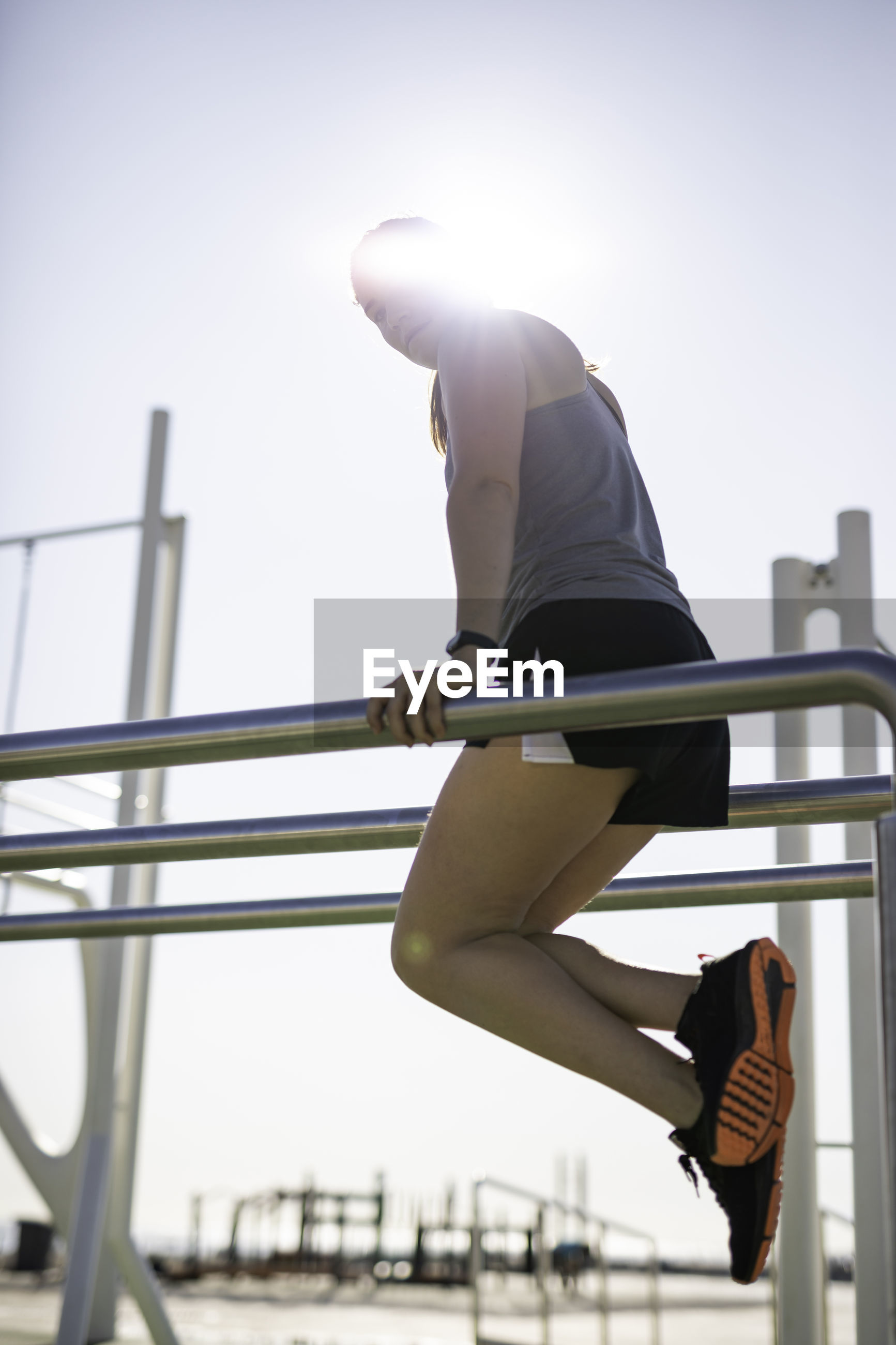 Woman exercising outdoors on sunny day