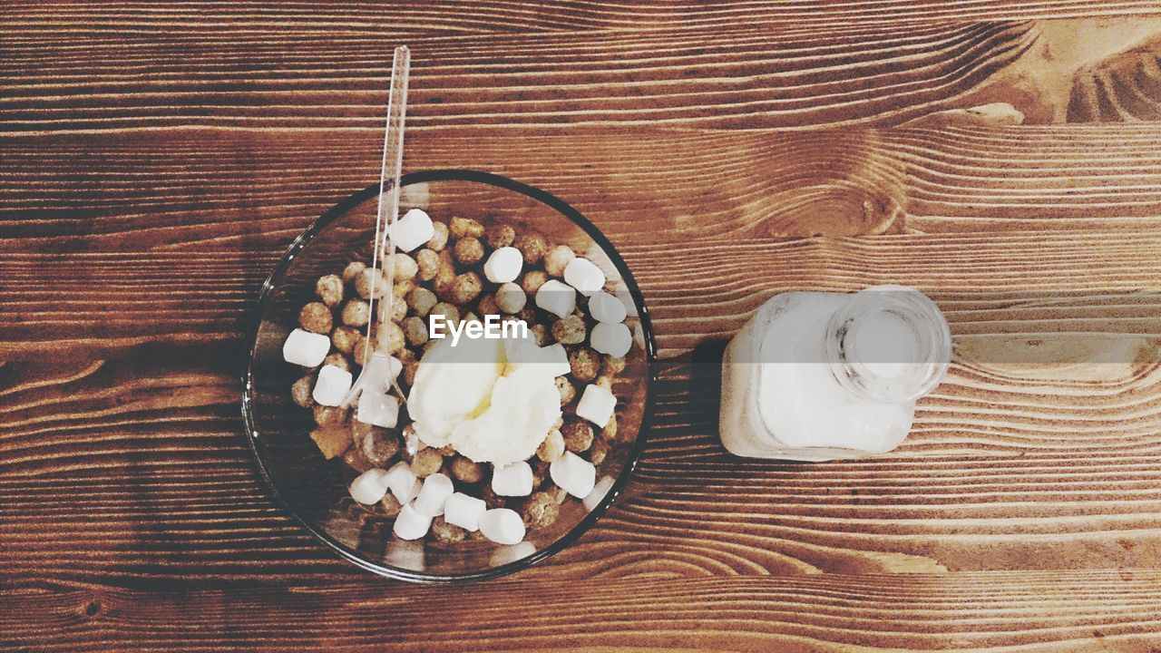 food and drink, table, directly above, still life, high angle view, indoors, food, sweet food, no people, freshness, wood - material, indulgence, temptation, dessert, close-up, ready-to-eat, day