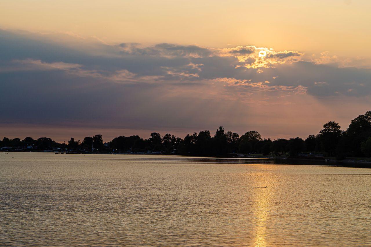 sky, sunset, water, scenics - nature, tranquility, beauty in nature, tranquil scene, cloud - sky, waterfront, orange color, idyllic, nature, no people, tree, silhouette, lake, non-urban scene, reflection, romantic sky