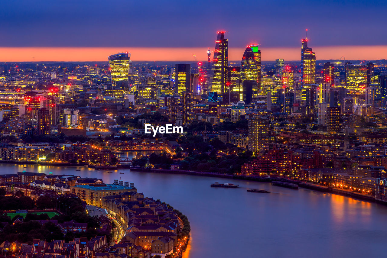 Aerial view of  illuminated london cityscape at sunset