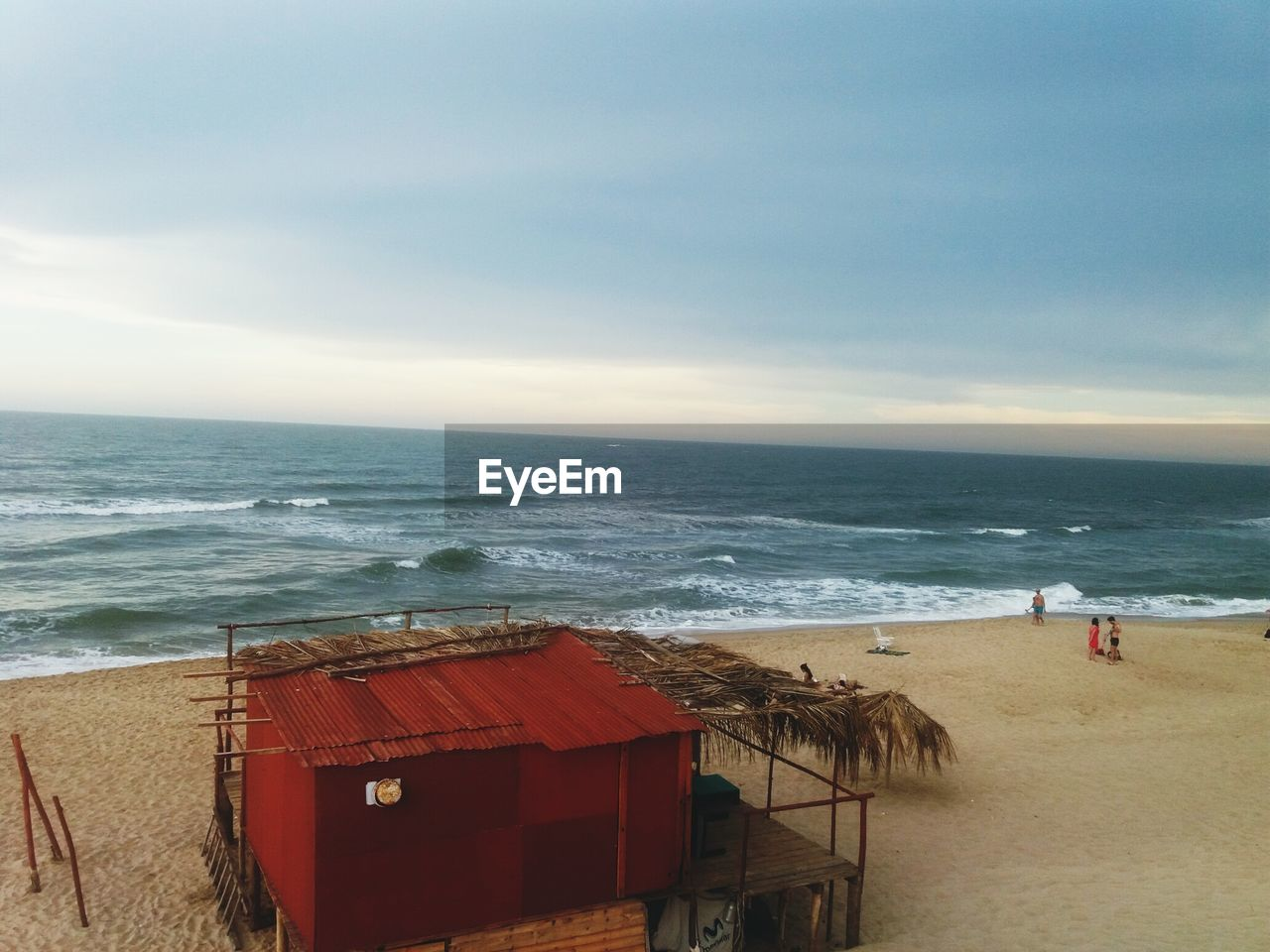 sea, water, horizon, horizon over water, beach, land, sky, beauty in nature, scenics - nature, wave, nature, cloud - sky, motion, red, day, sand, incidental people, tranquil scene, outdoors