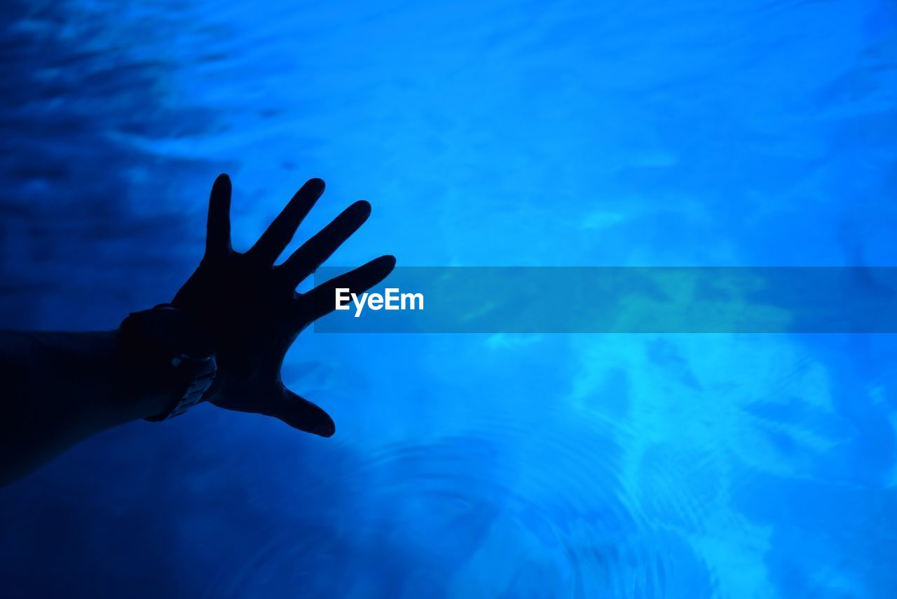 Close-up of hand in sea