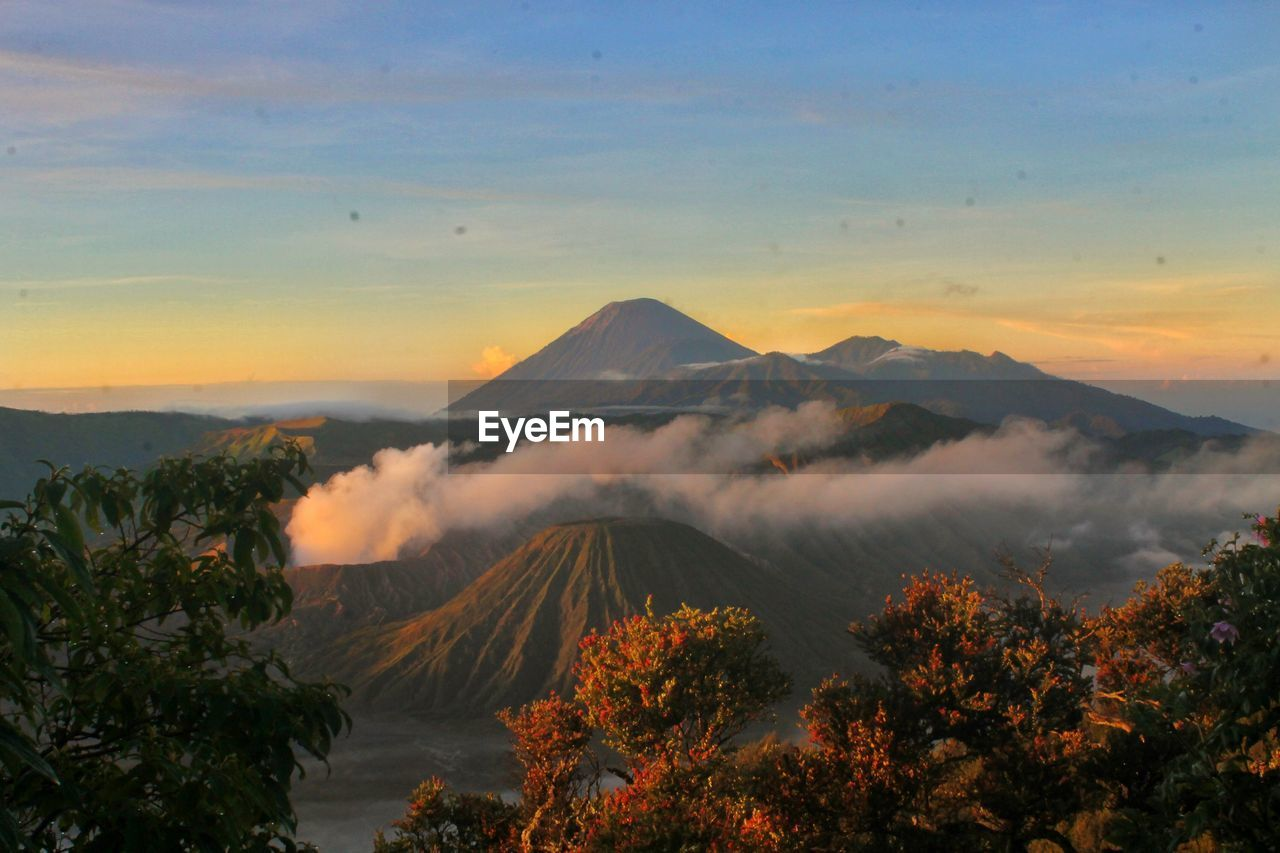 Scenic View Of Mount Semeru And Bromo Against Sky During Sunrise