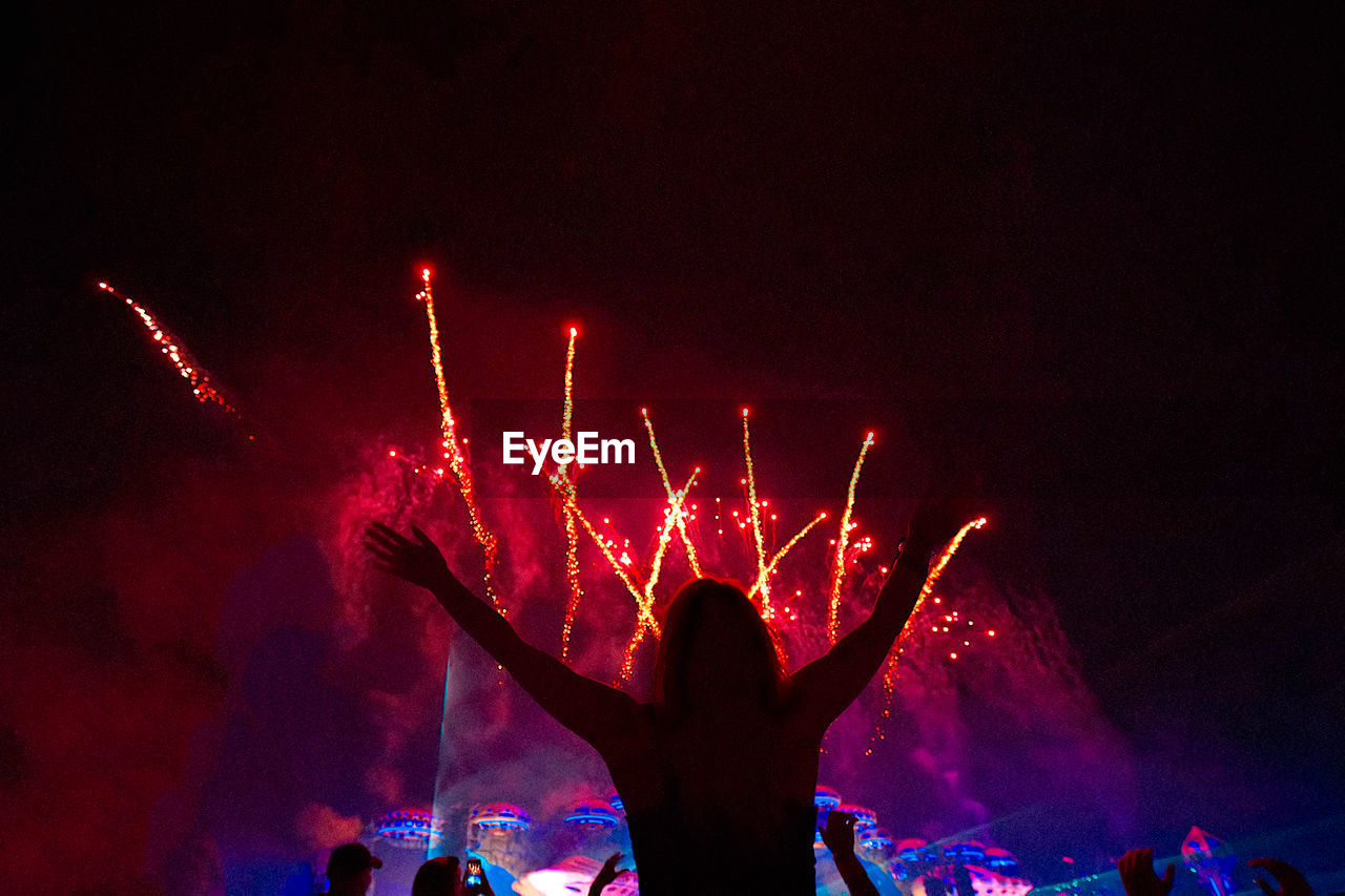 night, event, motion, celebration, illuminated, arts culture and entertainment, enjoyment, real people, group of people, people, lifestyles, crowd, women, leisure activity, human arm, fun, glowing, arms raised, light, firework, outdoors, festival, excitement, firework display