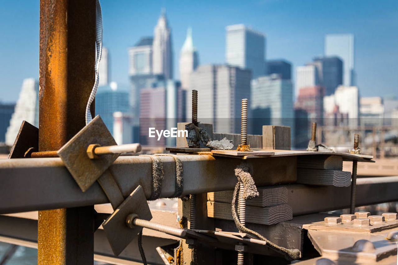 Architectural Detail Of Brooklyn Bridge In Front Of Cityscape