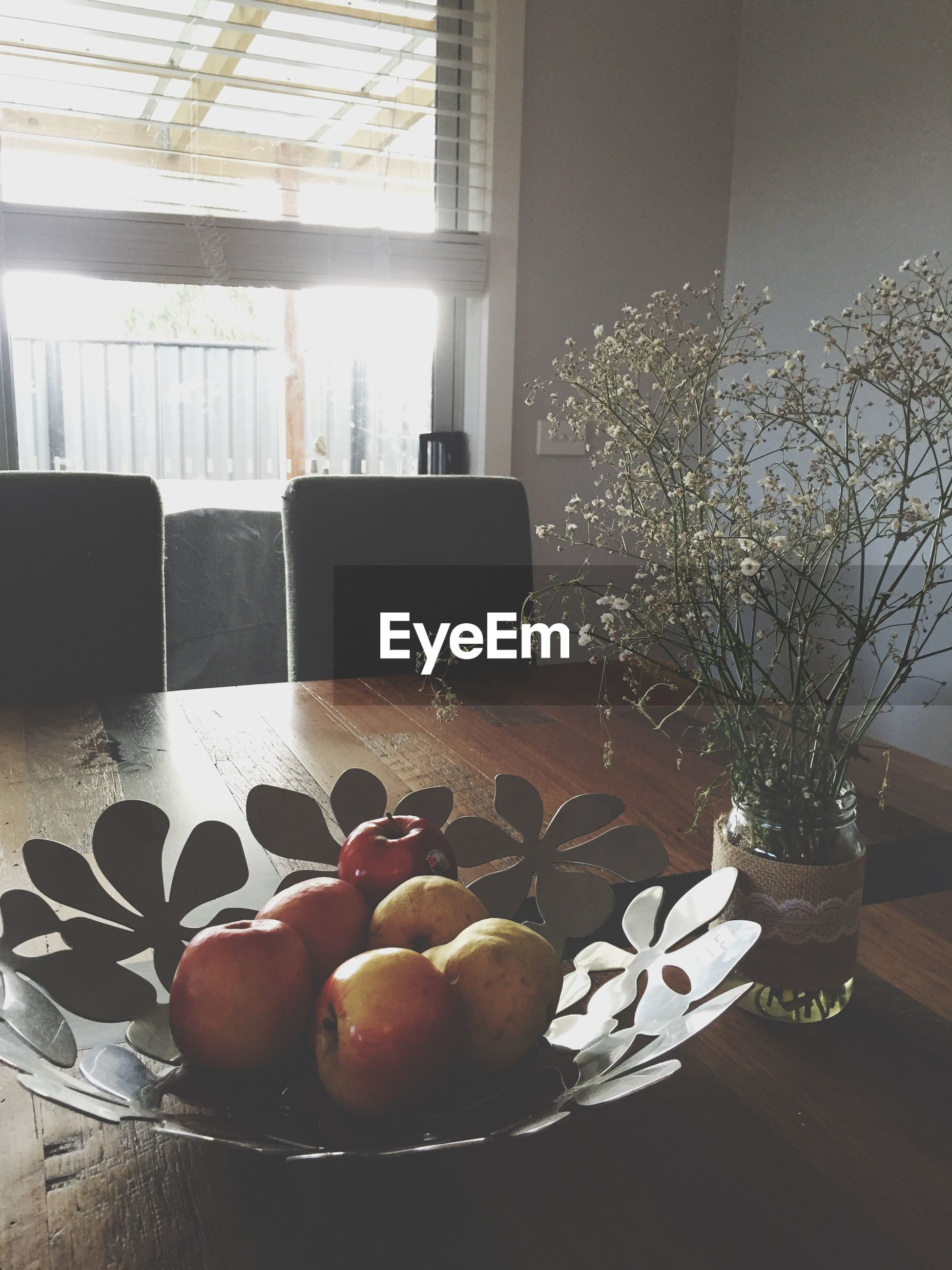 indoors, food and drink, table, freshness, food, still life, fruit, glass - material, home interior, healthy eating, decoration, no people, sweet food, window, architecture, basket, close-up, built structure, bowl, vase