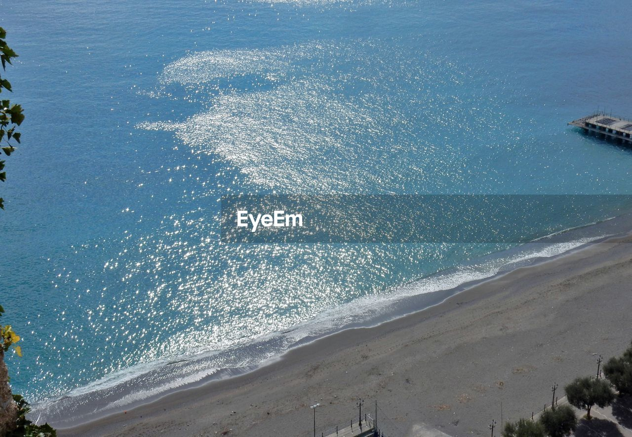 sea, water, beach, land, beauty in nature, nature, motion, day, wave, scenics - nature, high angle view, no people, outdoors, blue, aquatic sport, tranquility, sport, sand