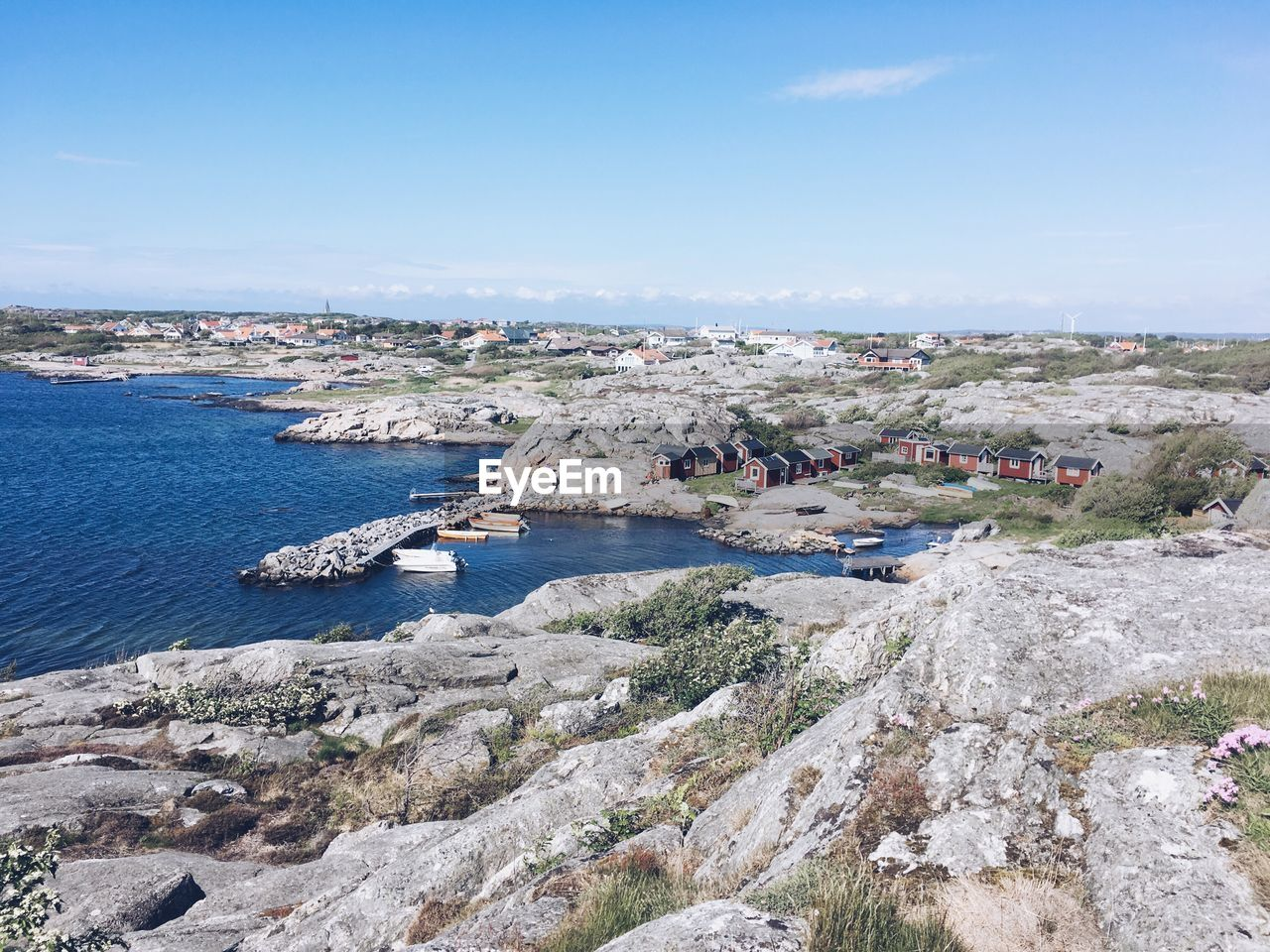 water, sky, sea, day, building exterior, architecture, built structure, nature, rock, transportation, nautical vessel, city, no people, solid, beauty in nature, rock - object, land, blue, scenics - nature, outdoors, townscape
