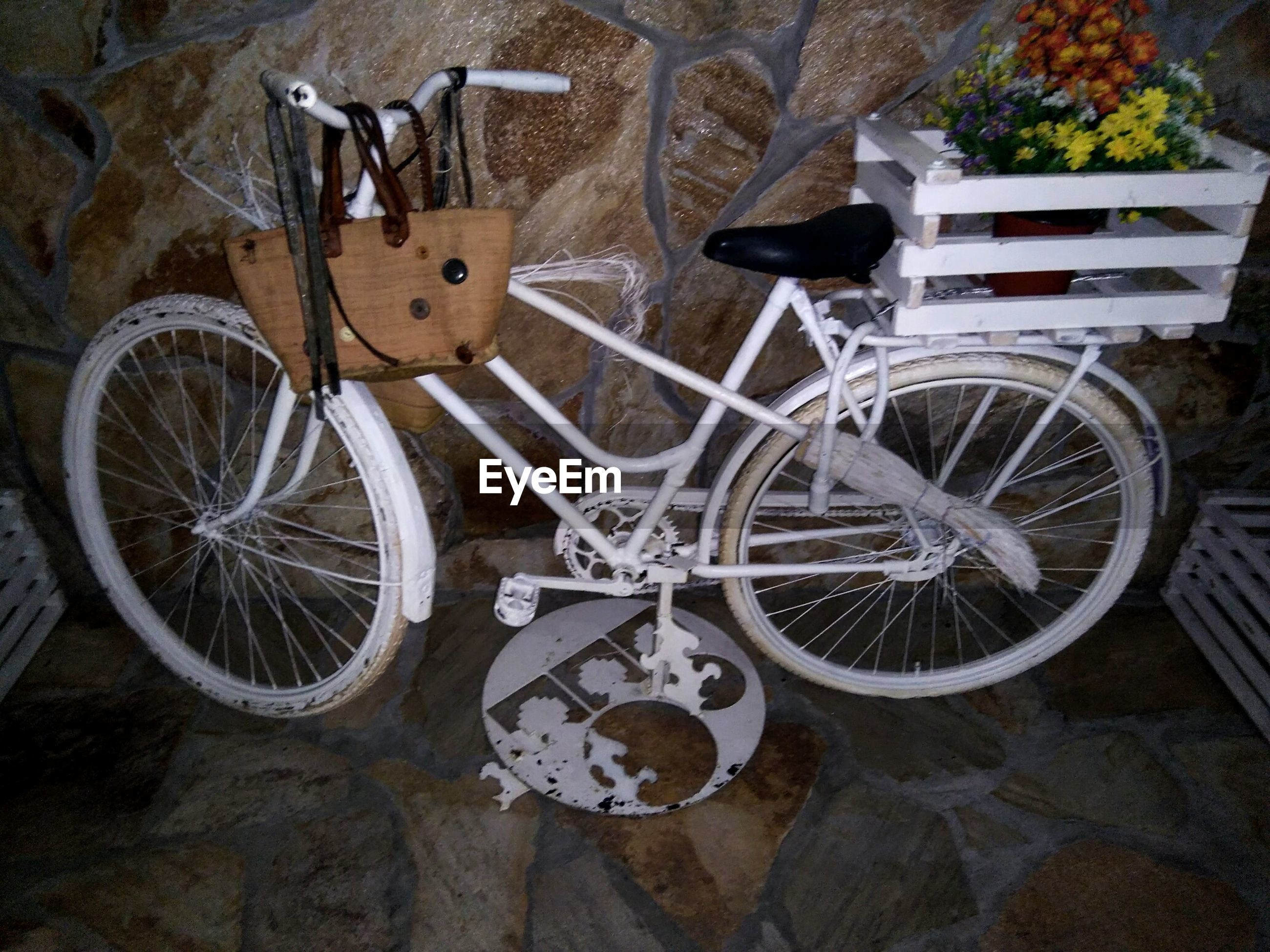 bicycle, stationary, wheel, transportation, land vehicle, mode of transport, high angle view, parking, no people, wall - building feature, old, outdoors, day, metal, parked, abandoned, old-fashioned, plant, still life, sunlight