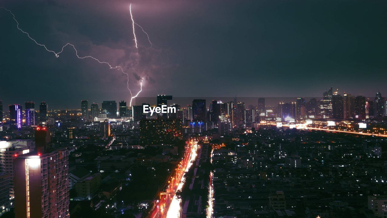 Panoramic shot of illuminated city against sky at night