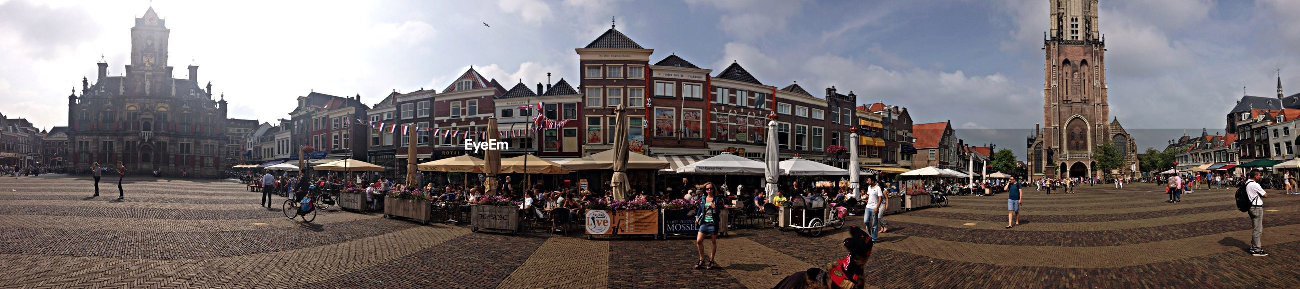 Panoramic view of market stalls in city against sky