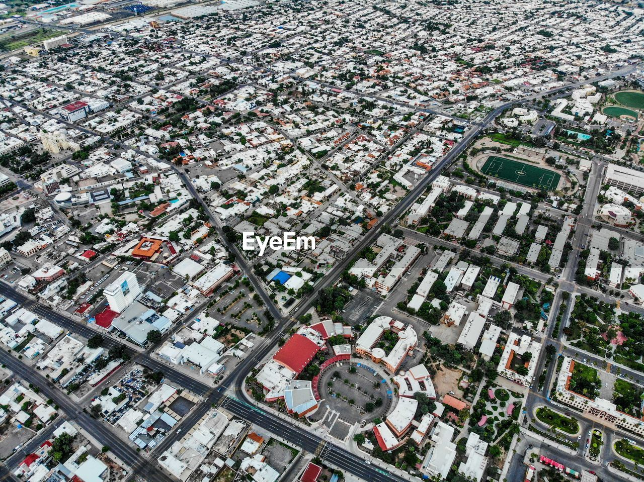 architecture, building exterior, city, built structure, high angle view, building, cityscape, residential district, aerial view, no people, day, road, outdoors, roof, community, nature, house, urban sprawl