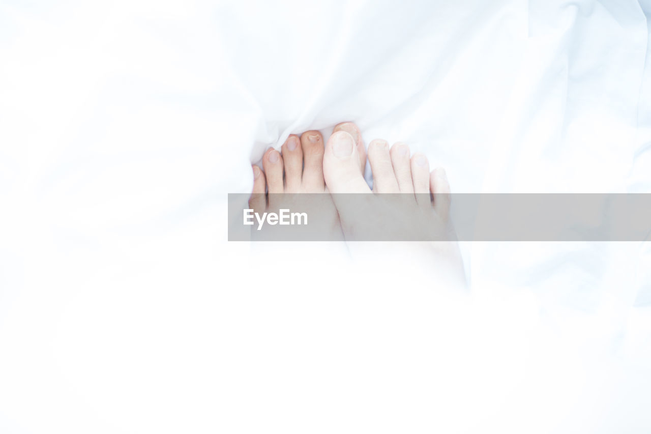 Close-up of toes of woman