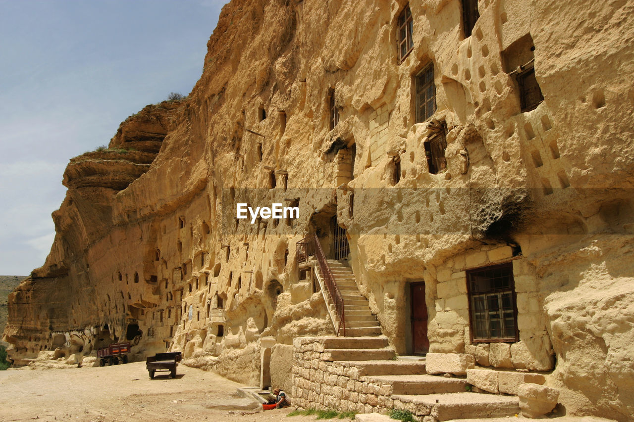 architecture, built structure, building exterior, rock, solid, history, rock - object, the past, building, day, ancient civilization, nature, rock formation, sky, ancient, old, no people, travel destinations, travel, sunlight, outdoors, archaeology, ruined