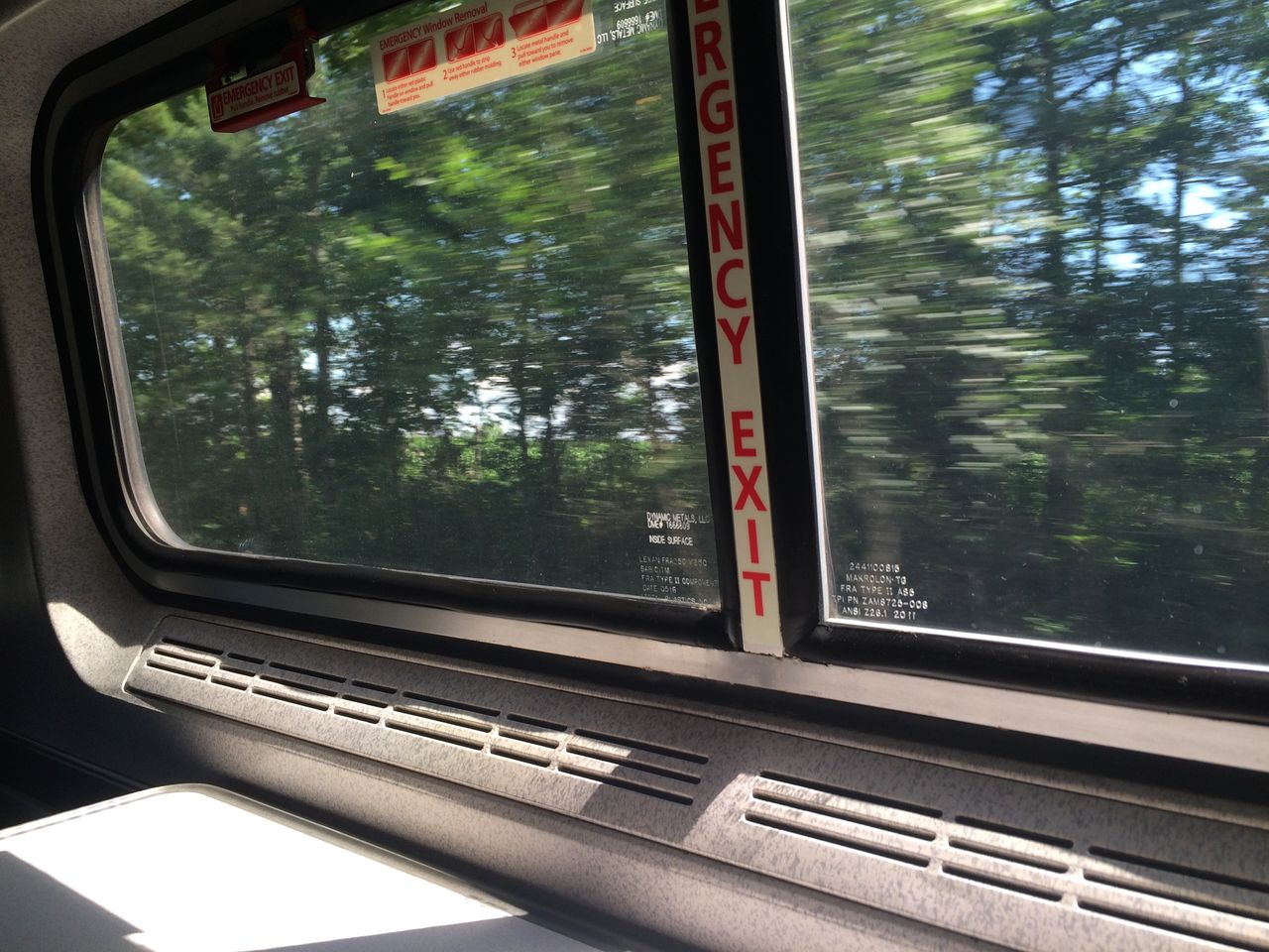 CLOSE-UP OF CAR WINDOW WITH REFLECTION