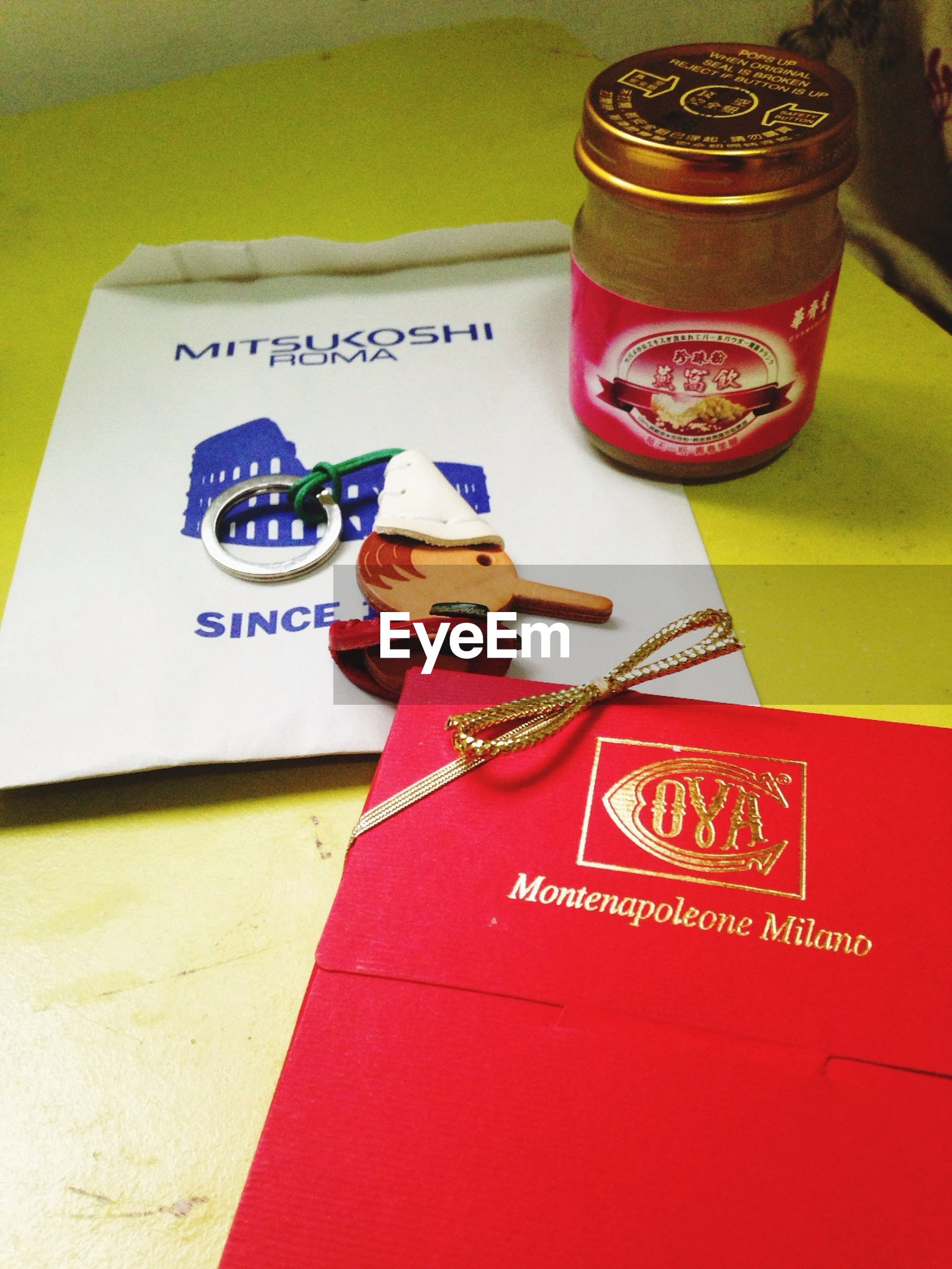 indoors, text, western script, communication, still life, table, close-up, paper, high angle view, number, message, non-western script, no people, variation, handwriting, red, book, education, finance, capital letter