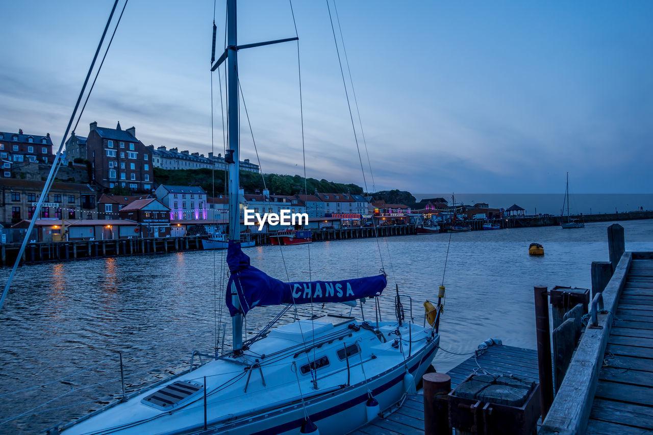 water, transportation, sky, nautical vessel, mode of transportation, architecture, nature, built structure, cloud - sky, moored, no people, dusk, building exterior, sea, sailboat, harbor, mast, pole, yacht