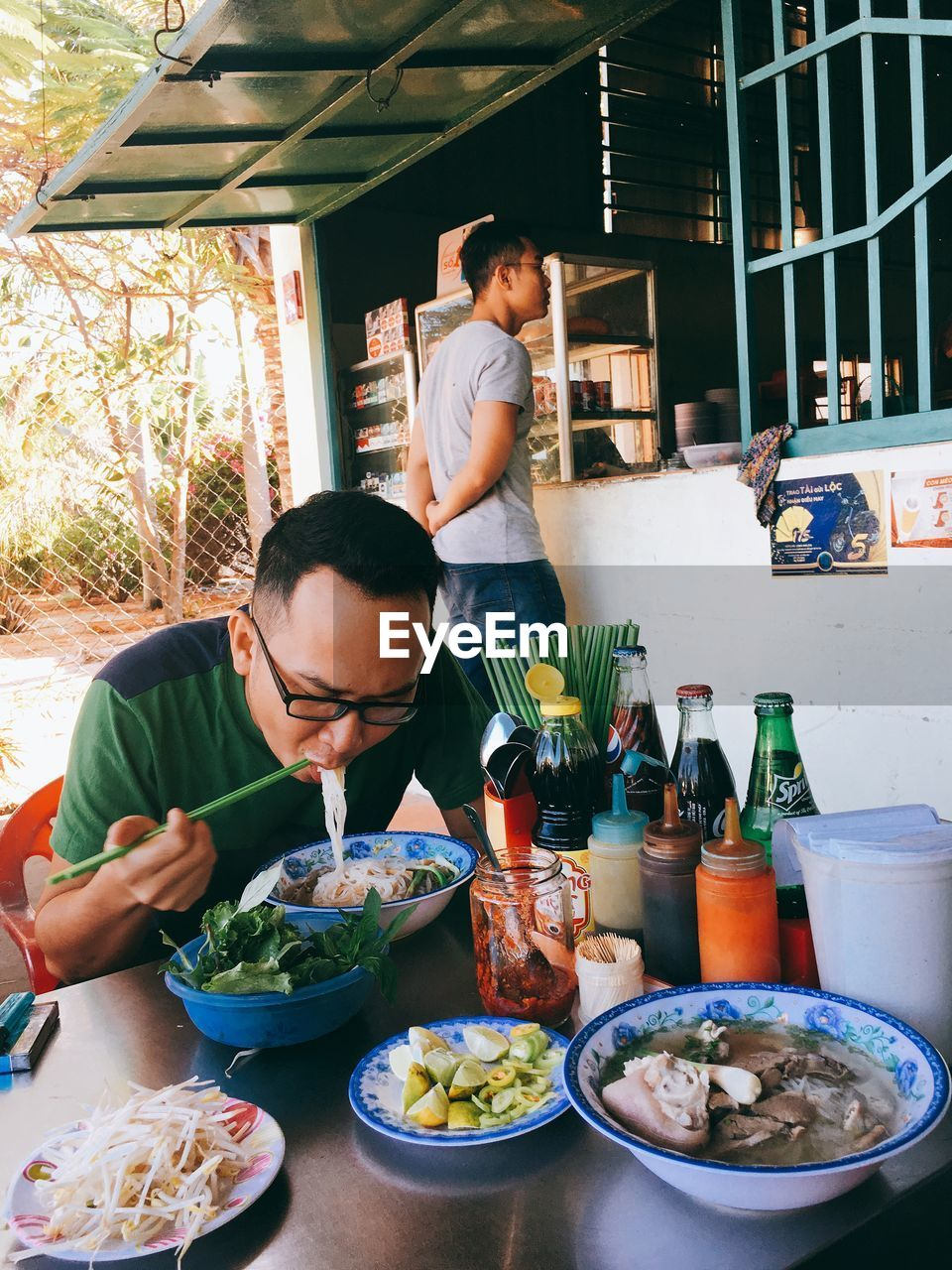 two people, food, table, food and drink, bowl, real people, plate, sitting, indoors, men, day, freshness, ready-to-eat, people