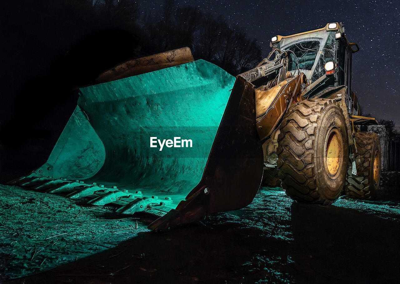 Close-Up Of Bulldozer At Night