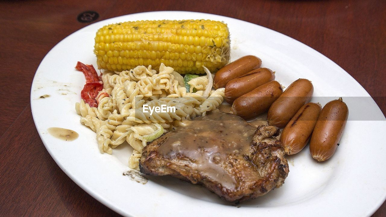 Close-up steak served with corn
