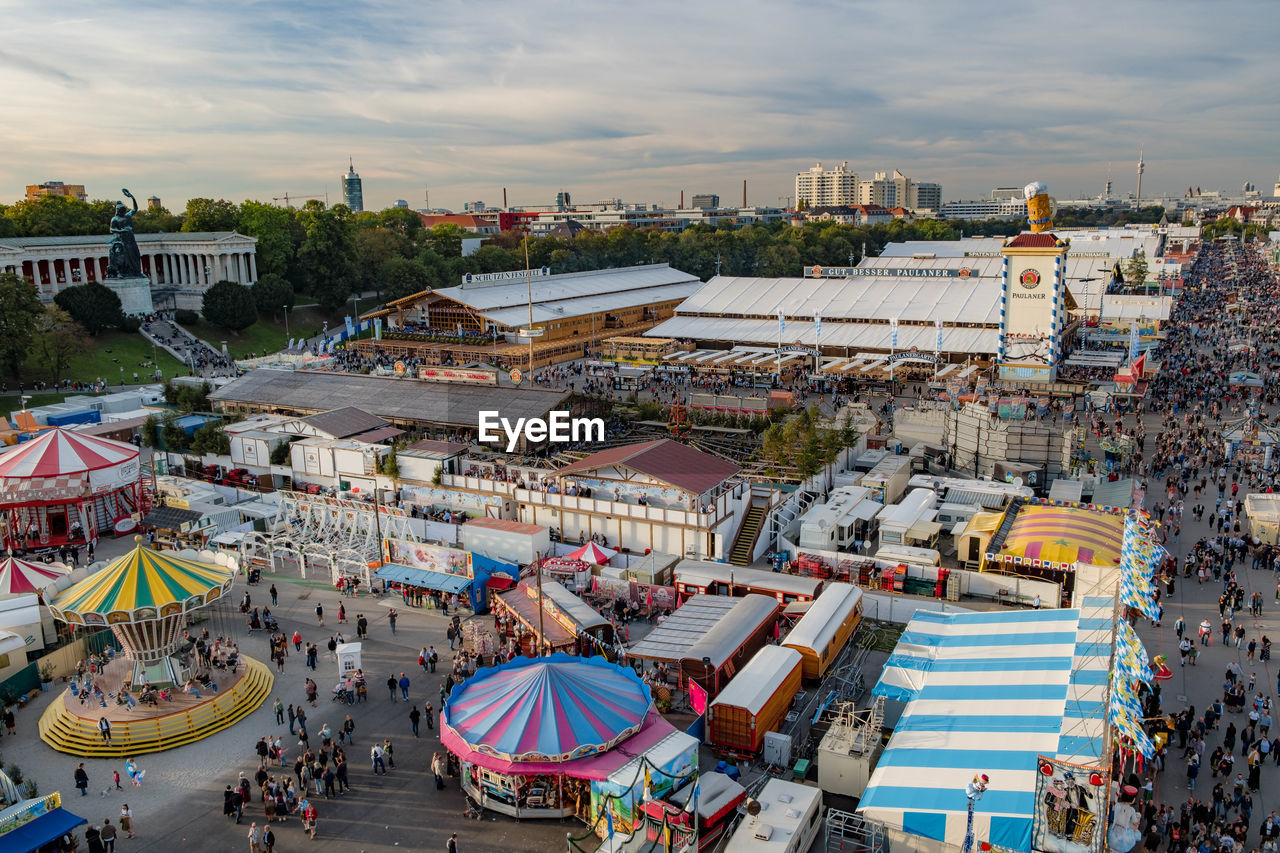 HIGH ANGLE VIEW OF PEOPLE AT AMUSEMENT PARK