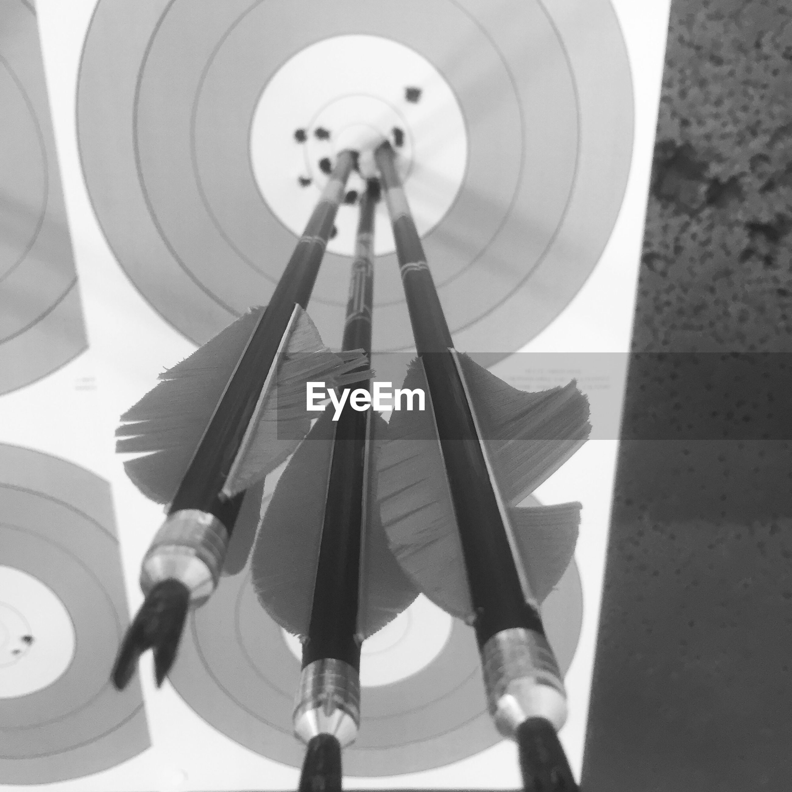 High angle view of arrow on dartboard