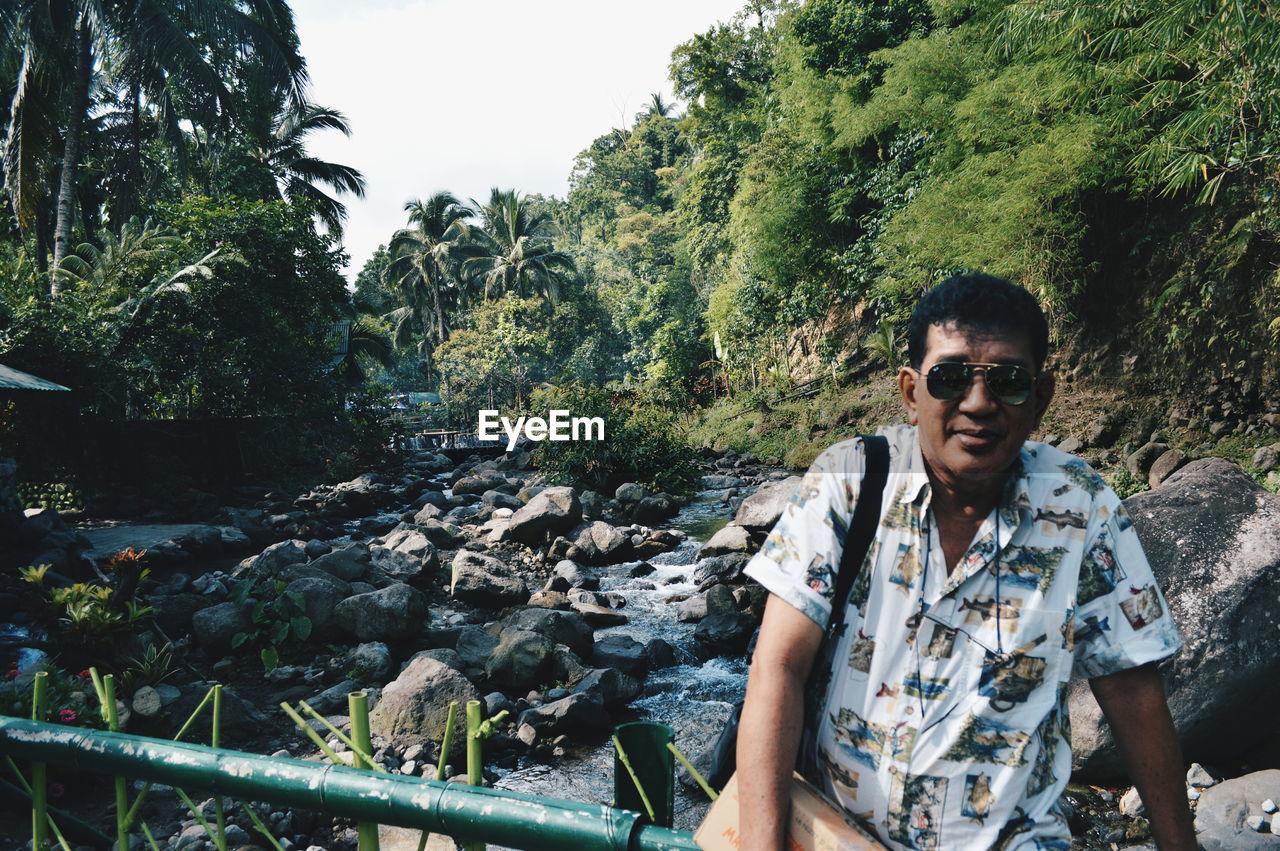 Portrait Of Tourist On Bridge