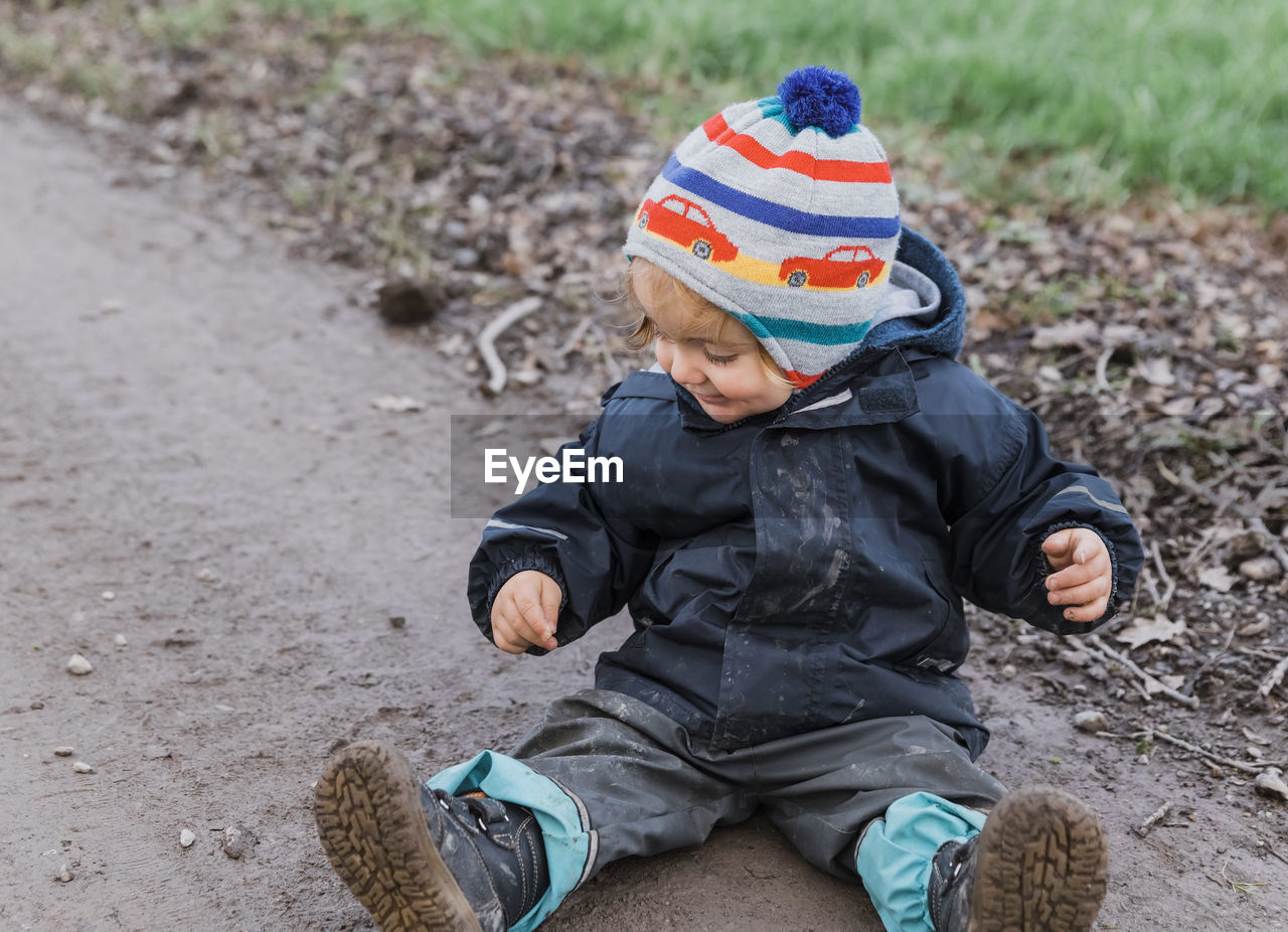 child, childhood, boys, innocence, men, males, baby, young, day, one person, real people, clothing, cute, knit hat, leisure activity, full length, babyhood, casual clothing, warm clothing, outdoors