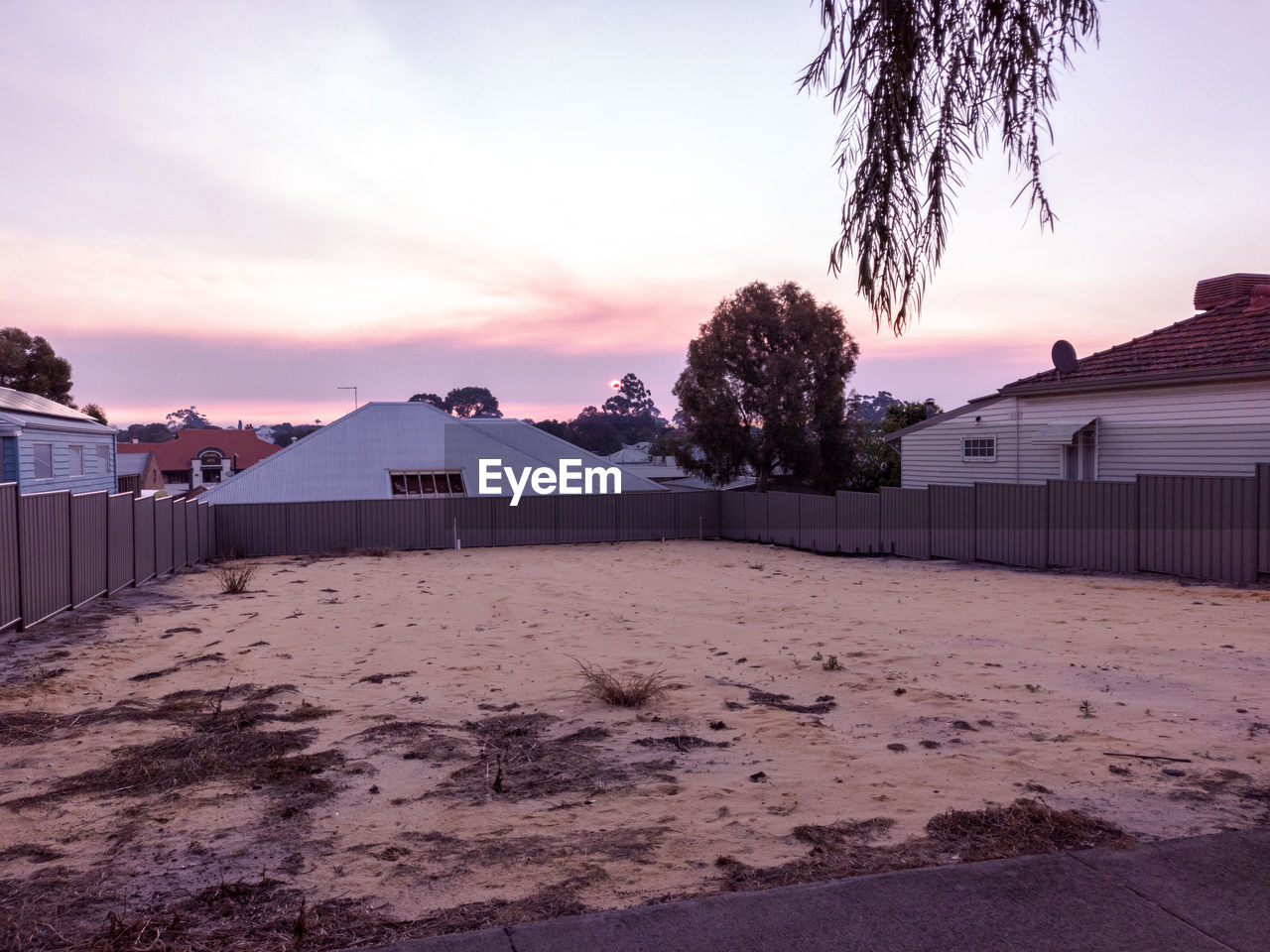 sky, building exterior, built structure, architecture, tree, sunset, building, nature, land, plant, house, residential district, no people, cloud - sky, sand, mountain, outdoors, beauty in nature, scenics - nature, dusk