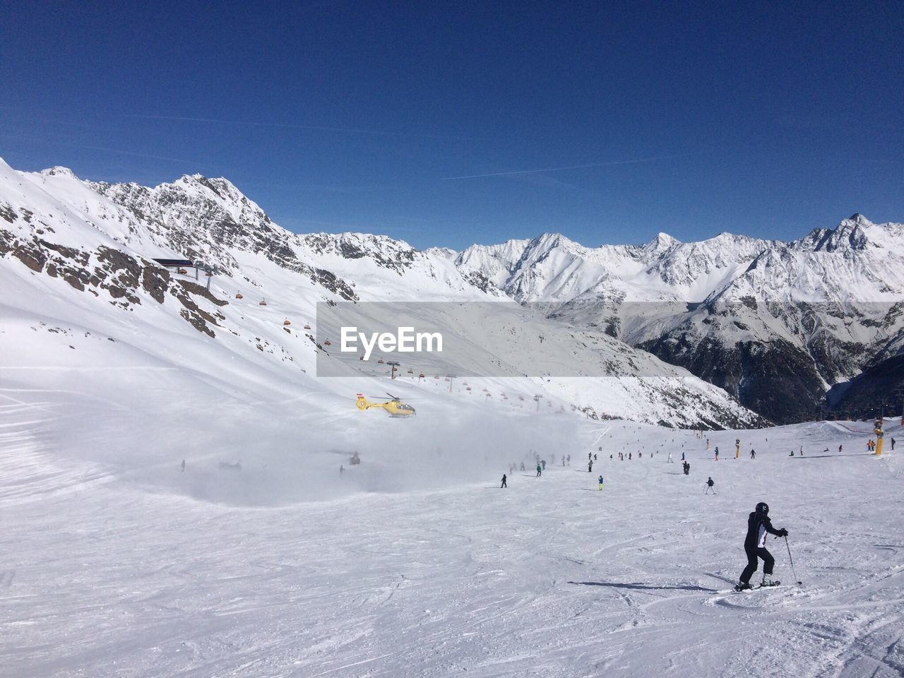 Scenic View Of Snowcapped Mountain Against Clear Blue Sky