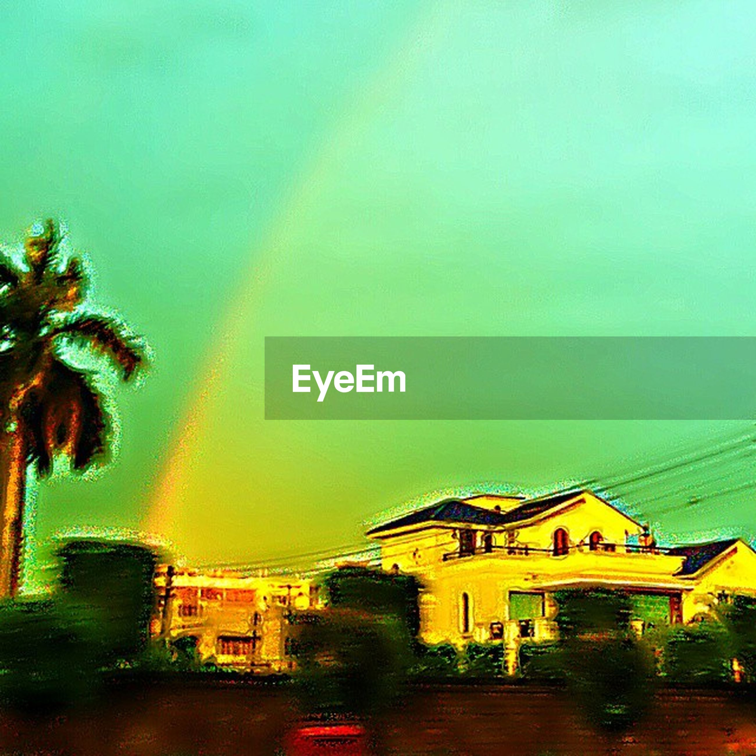 architecture, building exterior, built structure, rainbow, tree, house, residential structure, sky, copy space, palm tree, residential building, illuminated, clear sky, multi colored, outdoors, residential district, city, nature, no people, dusk